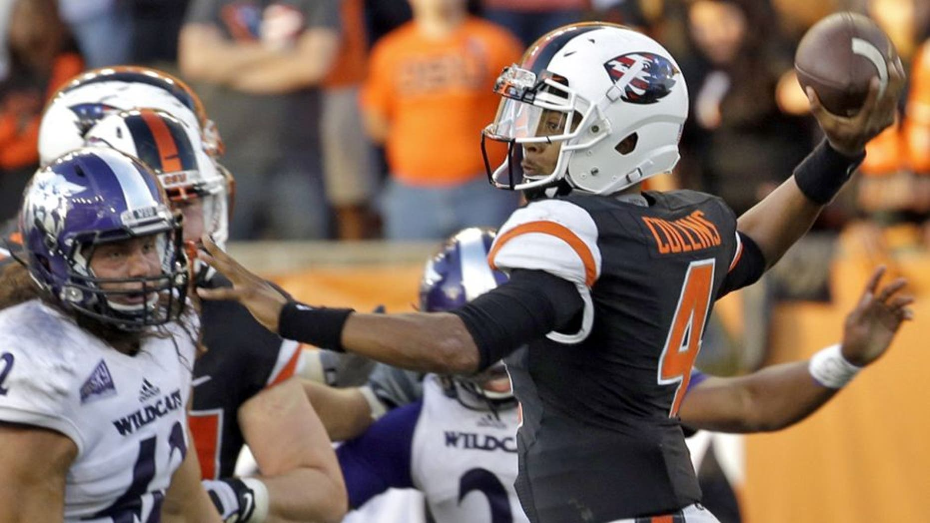 Oregon State quarterback Seth Collins, right, throws as Weber State defensive lineman Jonathan Carlson watches during the second half of an NCAA college football in Corvallis, Ore., Friday, Sept. 4, 2015. Oregon State won 26-7. (AP Photo/Don Ryan)