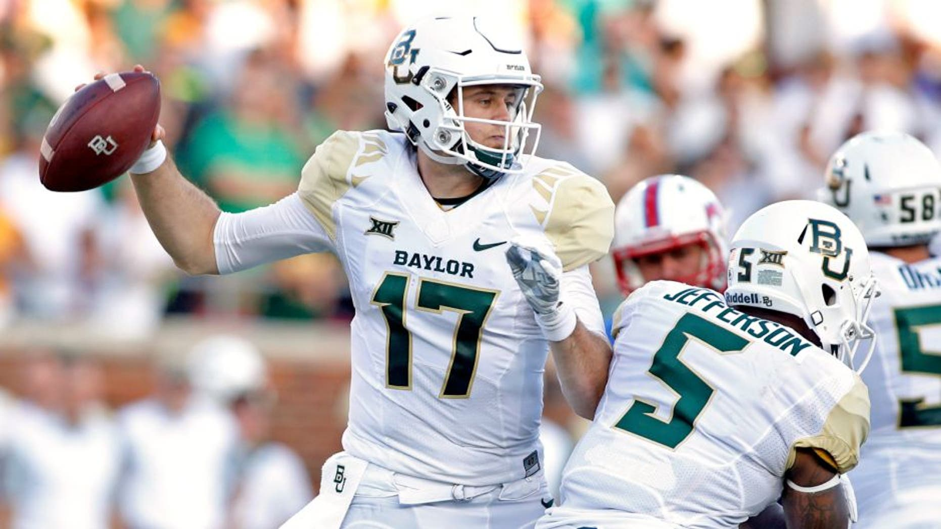 Sep 4, 2015; Dallas, TX, USA; Baylor Bears quarterback Seth Russell (17) throws a pass in the first quarter against the Southern Methodist Mustangs at Gerald J. Ford Stadium. Mandatory Credit: Tim Heitman-USA TODAY Sports