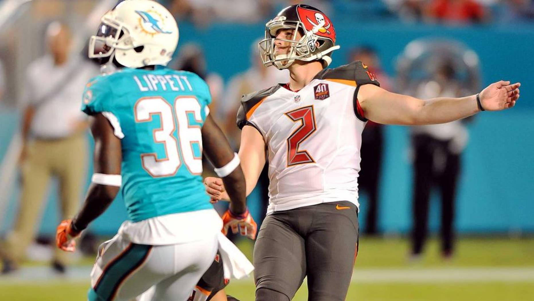 Sep 3, 2015; Miami Gardens, FL, USA; Tampa Bay Buccaneers kicker Kyle Brindza (2) kicks a field goal as Miami Dolphins defensive back Tony Lippett (36) looks on during the first half at Sun Life Stadium. Mandatory Credit: Steve Mitchell-USA TODAY Sports