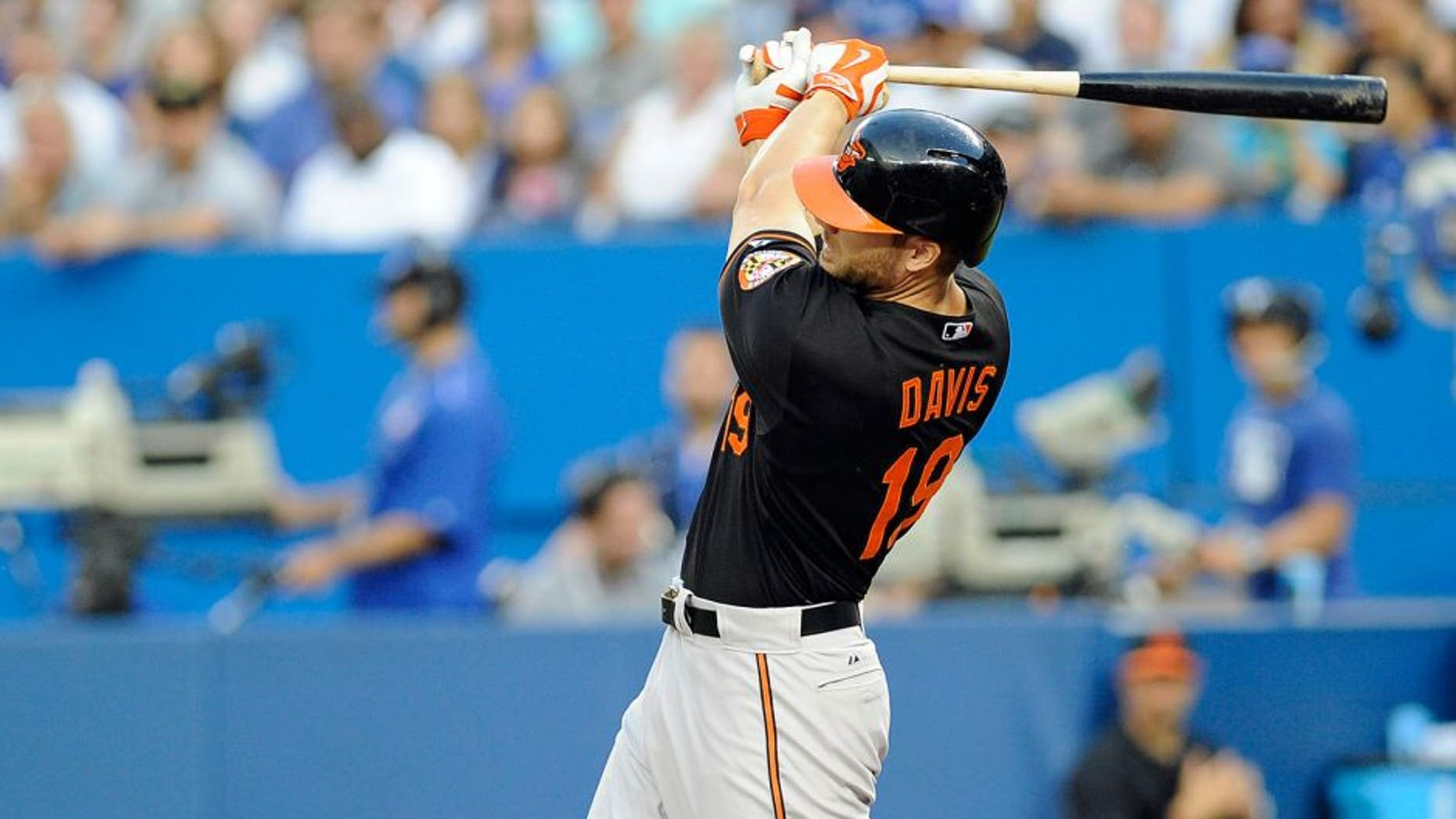 Sep 4, 2015; Toronto, Ontario, CAN; Baltimore Orioles first baseman Chris Davis (19) hits a home run against Toronto Blue Jays in the second inning at Rogers Centre. Mandatory Credit: Peter Llewellyn-USA TODAY Sports
