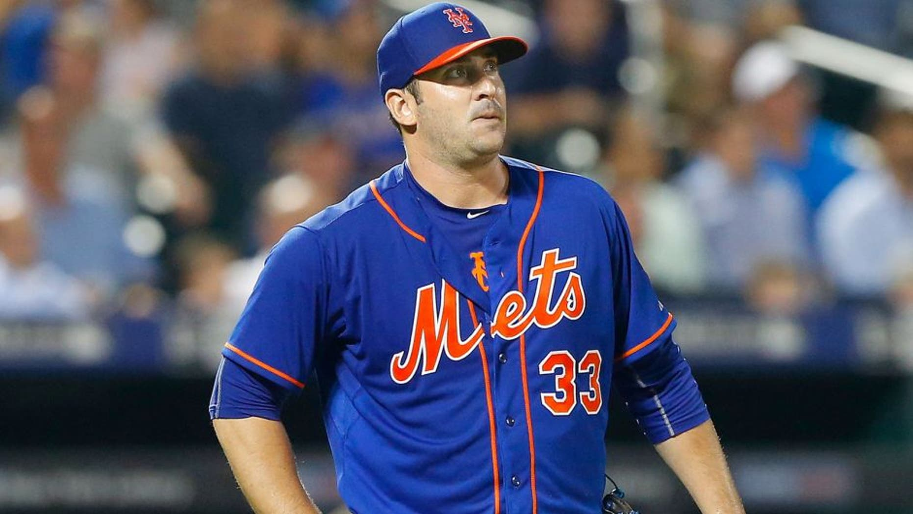 NEW YORK, NY - SEPTEMBER 02: Matt Harvey #33 of the New York Mets in action against the Philadelphia Phillies at Citi Field on September 2, 2015 in the Flushing neighborhood of the Queens borough of New York City. The Mets defeated the Phillies 9-4. (Photo by Jim McIsaac/Getty Images)