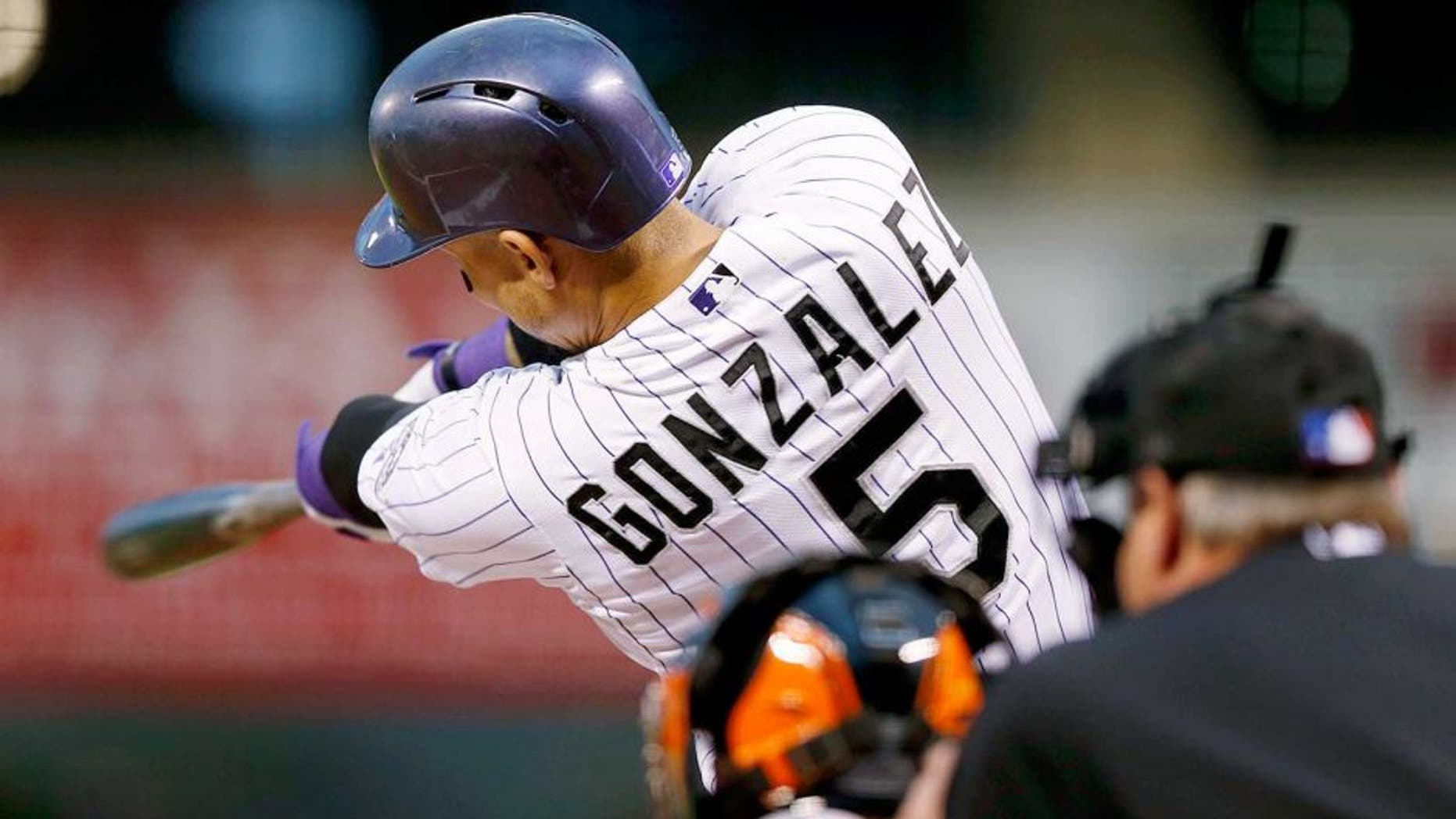 Colorado Rockies' Carlos Gonzalez connects for a solo home run off San Francisco Giants starting pitcher Chris Heston in the first inning of a baseball game Friday, Sept. 4, 2015, in Denver. (AP Photo/David Zalubowski)