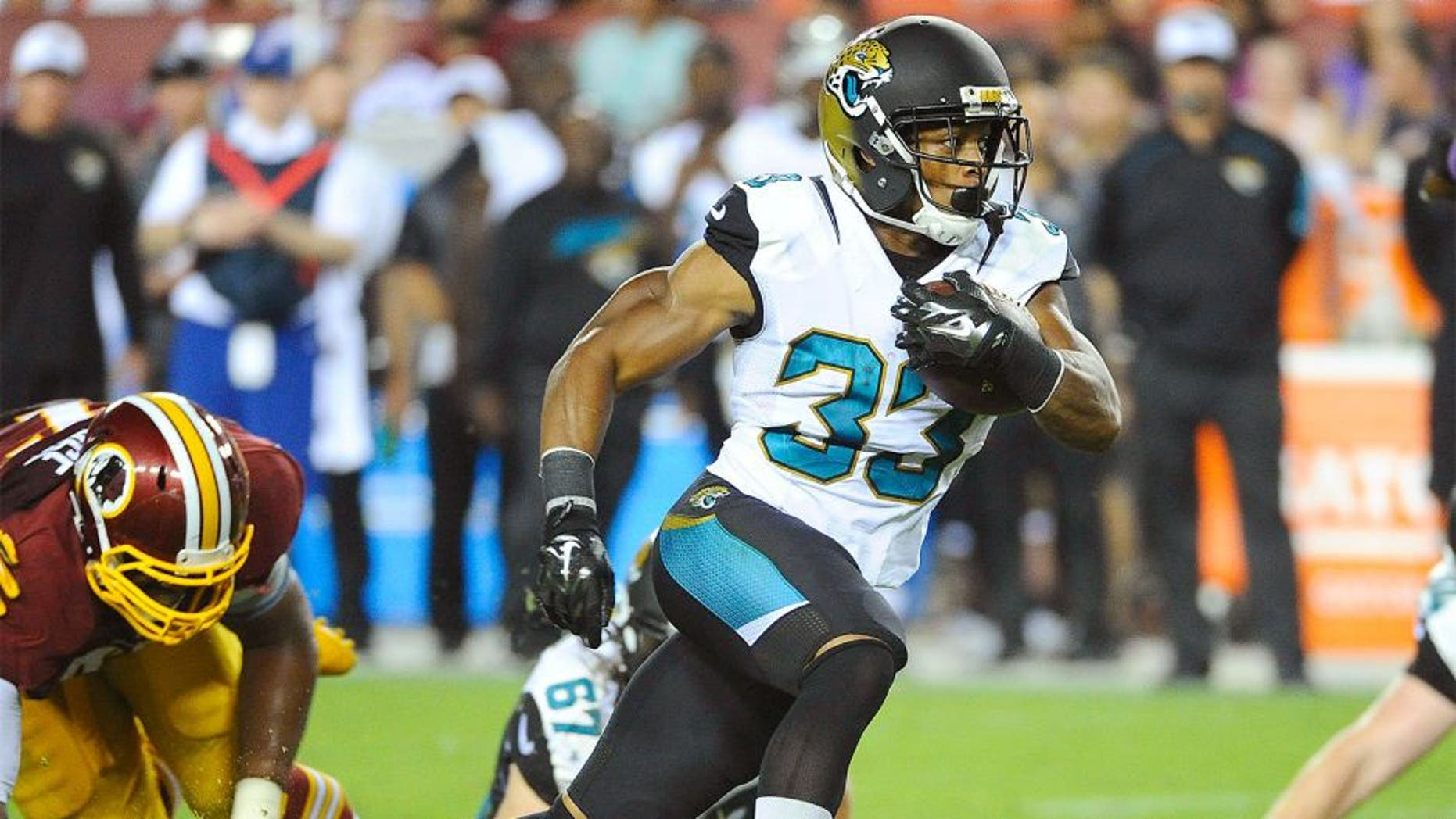 Sep 3, 2015; Landover, MD, USA; Jacksonville Jaguars running back Corey Grant (33) rushes the ball against the Washington Redskins during the second half at FedEx Field. The Jacksonville Jaguars won 17 - 16. Mandatory Credit: Brad Mills-USA TODAY Sports