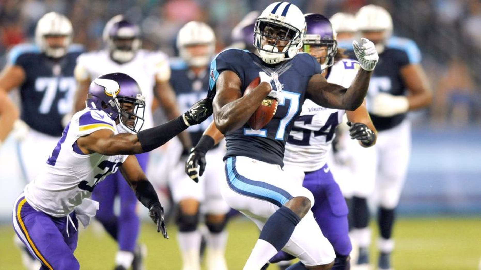 Sep 3, 2015; Nashville, TN, USA; Tennessee Titans receiver Dorial Green-Beckham (17) is tackled after a catch during the first half against the Minnesota Vikings at Nissan Stadium. Mandatory Credit: Christopher Hanewinckel-USA TODAY Sports