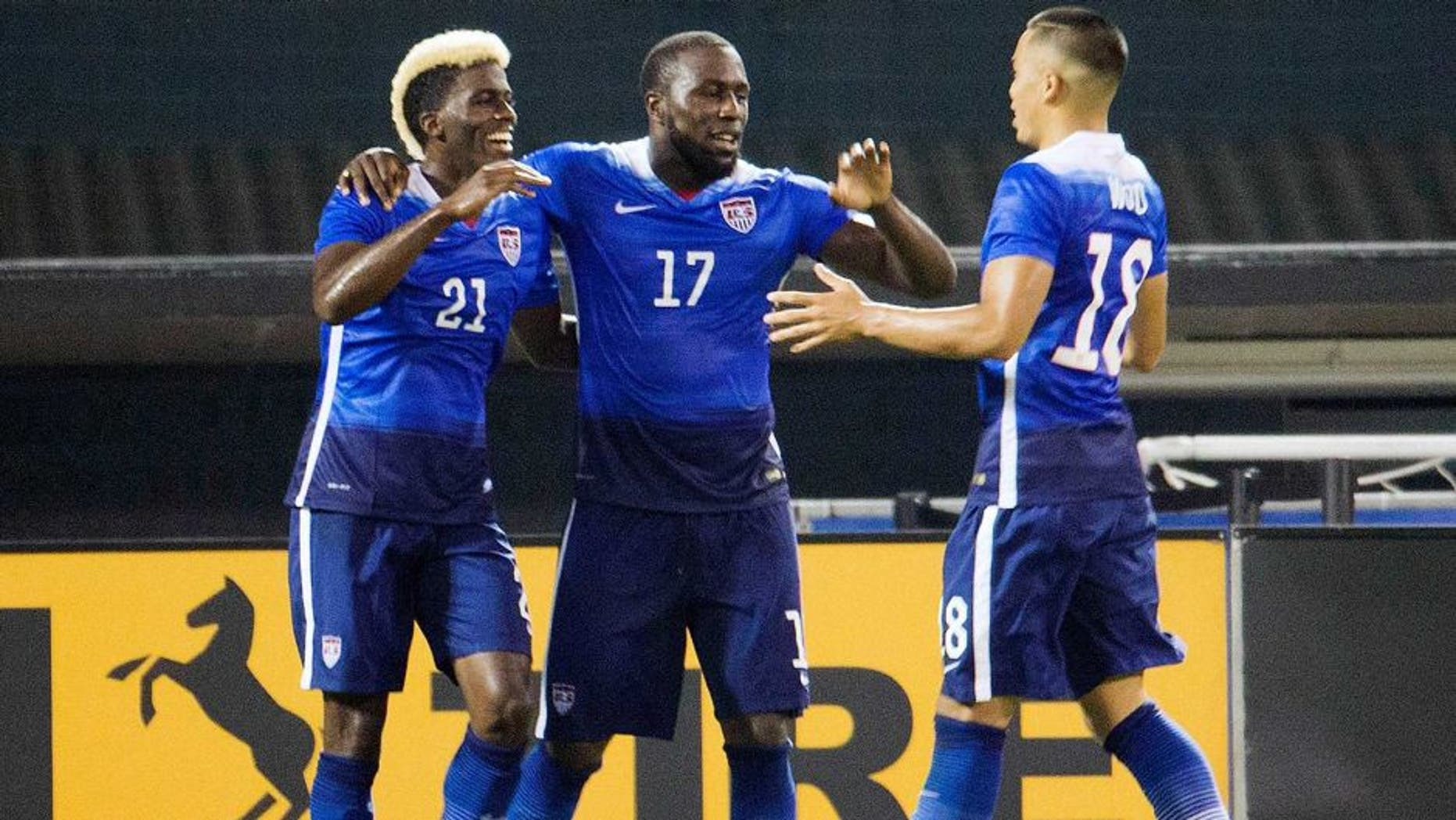 U.S. forward Jozy Altidore (17) celebrates his second goal with teammates forwards Gyasi Zardes (21) and Bobby Wood (18) during the second half of an international friendly soccer match against Peru, Friday, Sept. 4, 2015 at RFK Stadium in Washington. (AP Photo/Pablo Martinez Monsivais)
