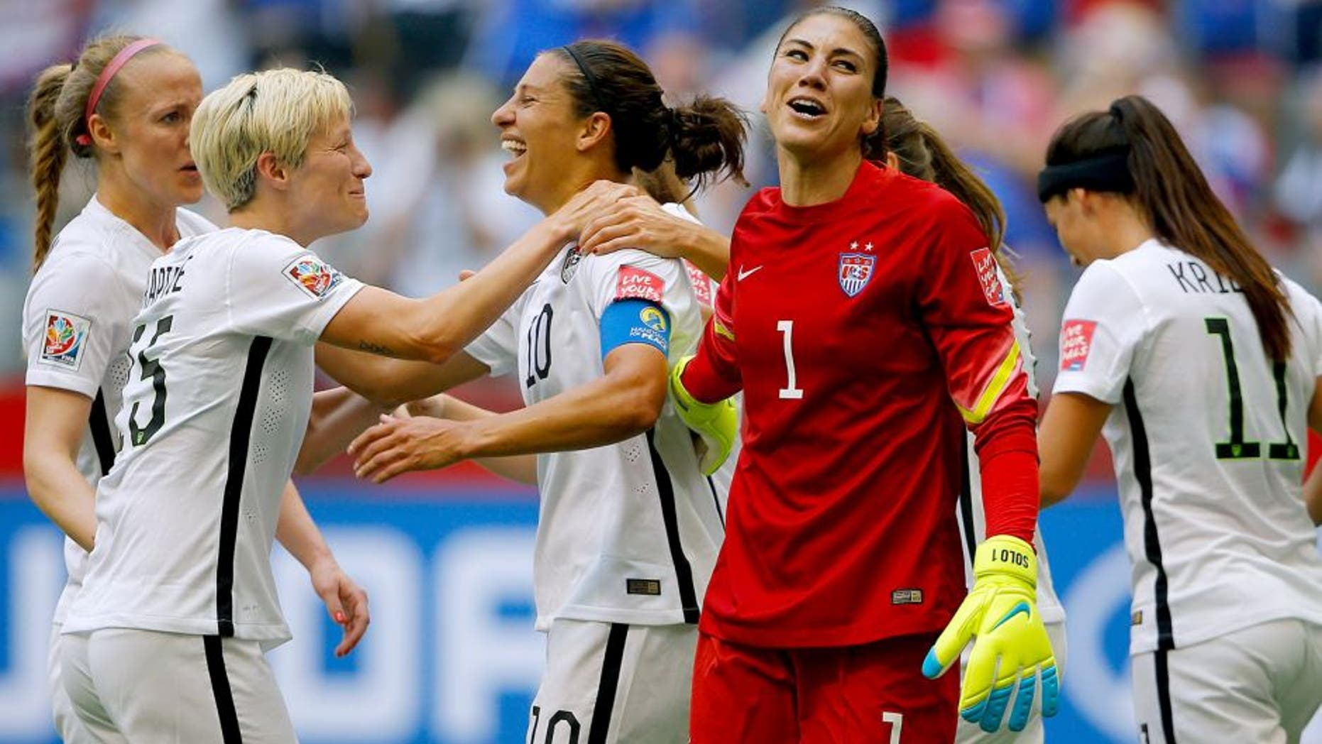 VANCOUVER, BC - JULY 05: Carli Lloyd #10 of the United States of America celebrates after her third goal against Japan with goalkeeper Hope Solo #1 and Megan Rapinoe #15 in the FIFA Women's World Cup Canada 2015 Final at BC Place Stadium on July 5, 2015 in Vancouver, Canada. (Photo by Kevin C. Cox/Getty Images)