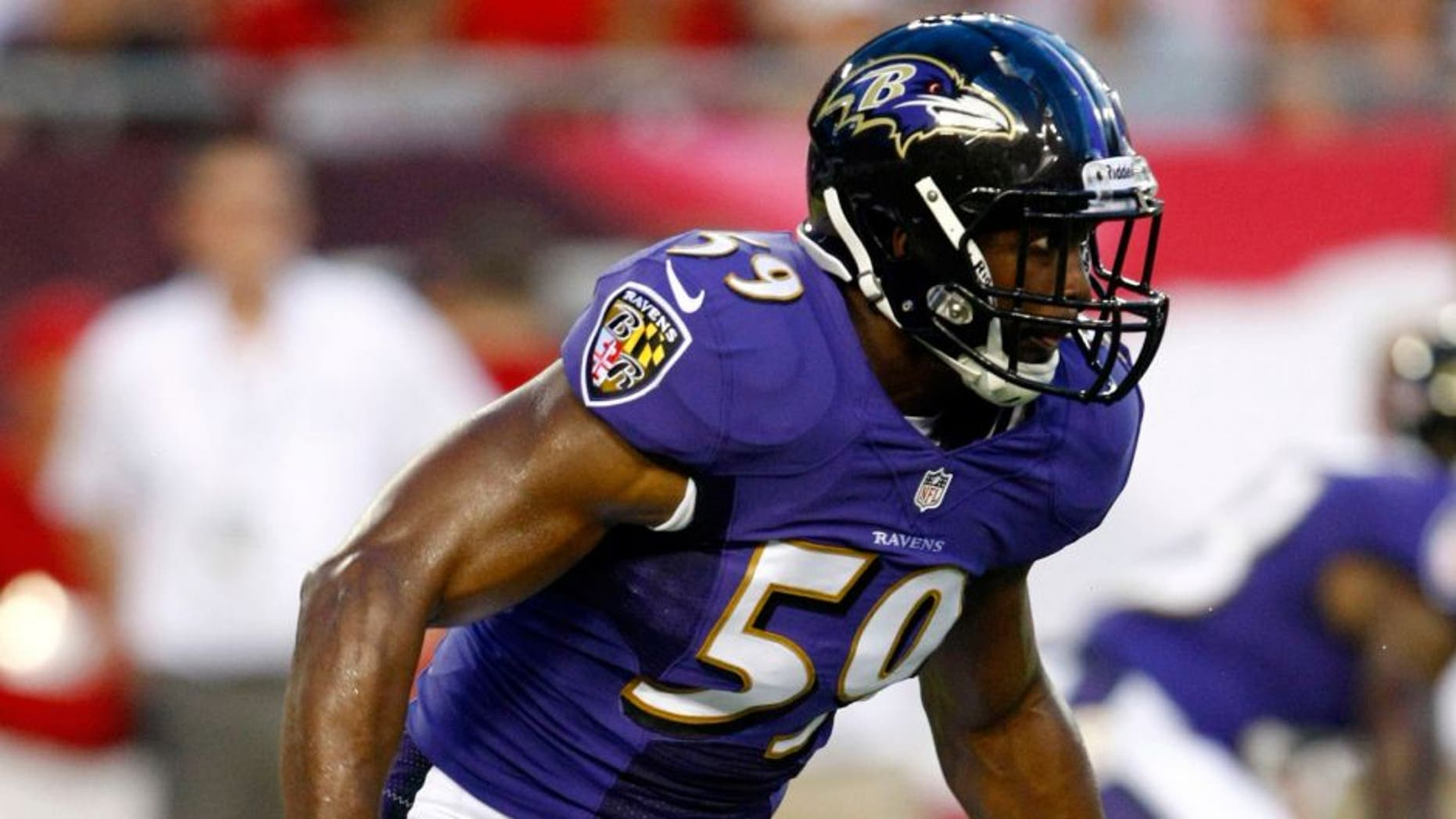 Aug 8, 2013; Tampa, FL, USA; Baltimore Ravens inside linebacker Arthur Brown (59) reacts to the play during the first quarter against the Tampa Bay Buccaneers at Raymond James Stadium. Mandatory Credit: Douglas Jones-USA TODAY Sports