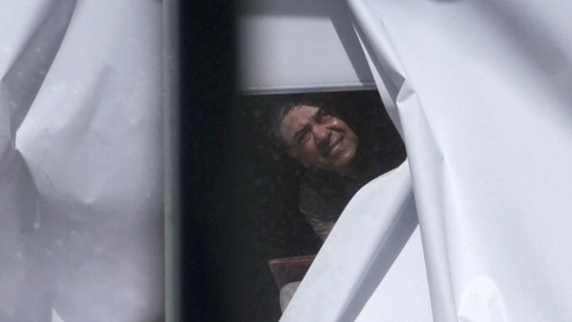 Sept. 6: A man believed to have strapped what appeared to be a bomb to himself looks out of a window next to the Parramatta court building near Sydney.