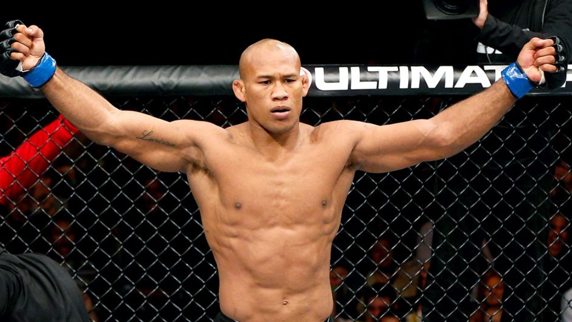 """Ronaldo """"Jacare"""" Souza reacts after knocking out Yushin Okami in their middleweight fight during the UFC on FOX Sports 1 event at Mineirinho Arena on September 4, 2013 in Belo Horizonte, Brazil. (Photo by Josh Hedges/Zuffa LLC/Zuffa LLC via Getty Images)"""