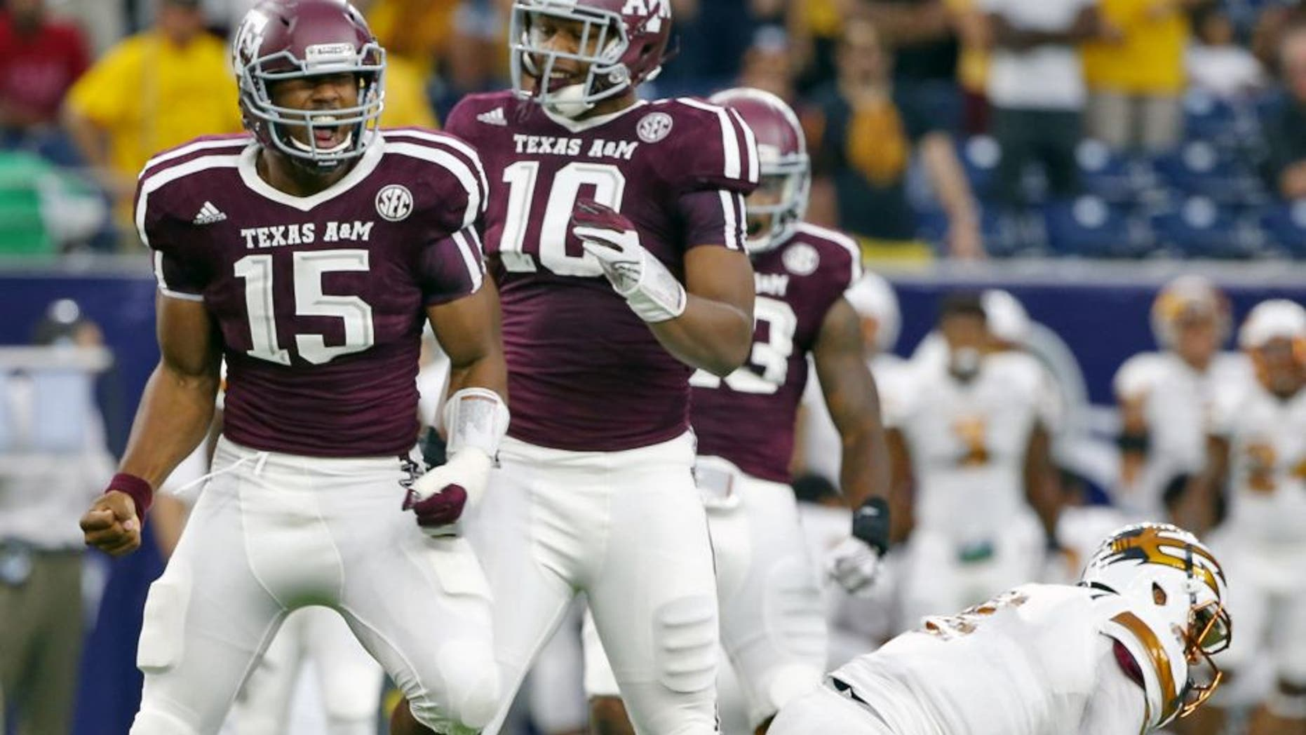 HOUSTON, TX - SEPTEMBER 05: Myles Garrett #15 of the Texas A&M Aggies celebrates after his sack of Mike Bercovici #2 of the Arizona State Sun Devils during the first half of their game during the Advocare Texas Kickoff at NRG Stadium on September 5, 2015 in Houston, Texas. (Photo by Scott Halleran/Getty Images)