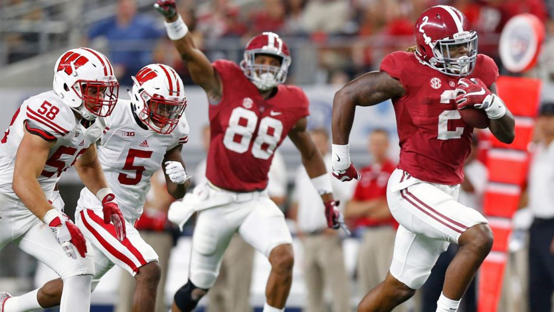 Sep 5, 2015; Arlington, TX, USA; Alabama Crimson Tide running back Derrick Henry (2) runs with the ball for a third quarter touchdown against Wisconsin Badgers linebacker Joe Schobert (58) and cornerback Darius Hillary (5) as Alabama Crimson Tide receiver O.J. Howard (88) celebrates at AT&T Stadium. Mandatory Credit: Matthew Emmons-USA TODAY Sports