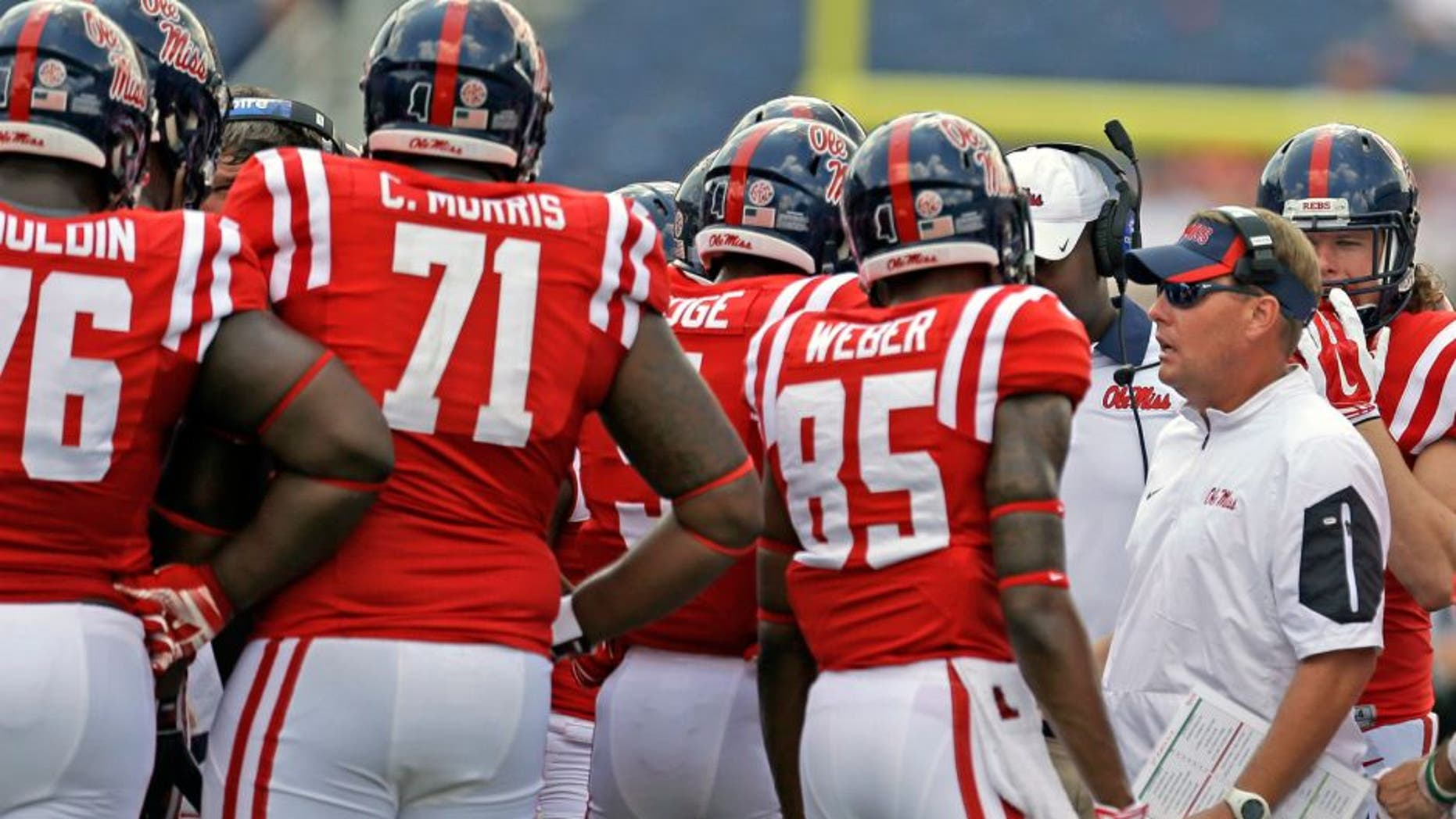 OXFORD MS -SEPTEMBER 5: Coach Hugh Freeze of the Mississippi Rebels talks to players during the second half of a NCAA college football game against the Tennessee Martin Skyhawks at Vaught-Hemingway Stadium on September 5, 2015 in Oxford, Mississippi. (Photo by Butch Dill/Getty Images)