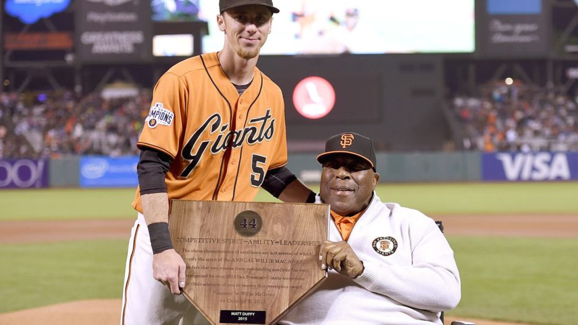 SAN FRANCISCO, CA - OCTOBER 02: Matt Duffy #5 of the San Francisco Giants, this year's recepient of the Willie Mac Award, stands with the former Giants great Willie McCovey prior to the game against the Colorado Rockies at AT&T Park on October 2, 2015 in San Francisco, California. (Photo by Thearon W. Henderson/Getty Images)