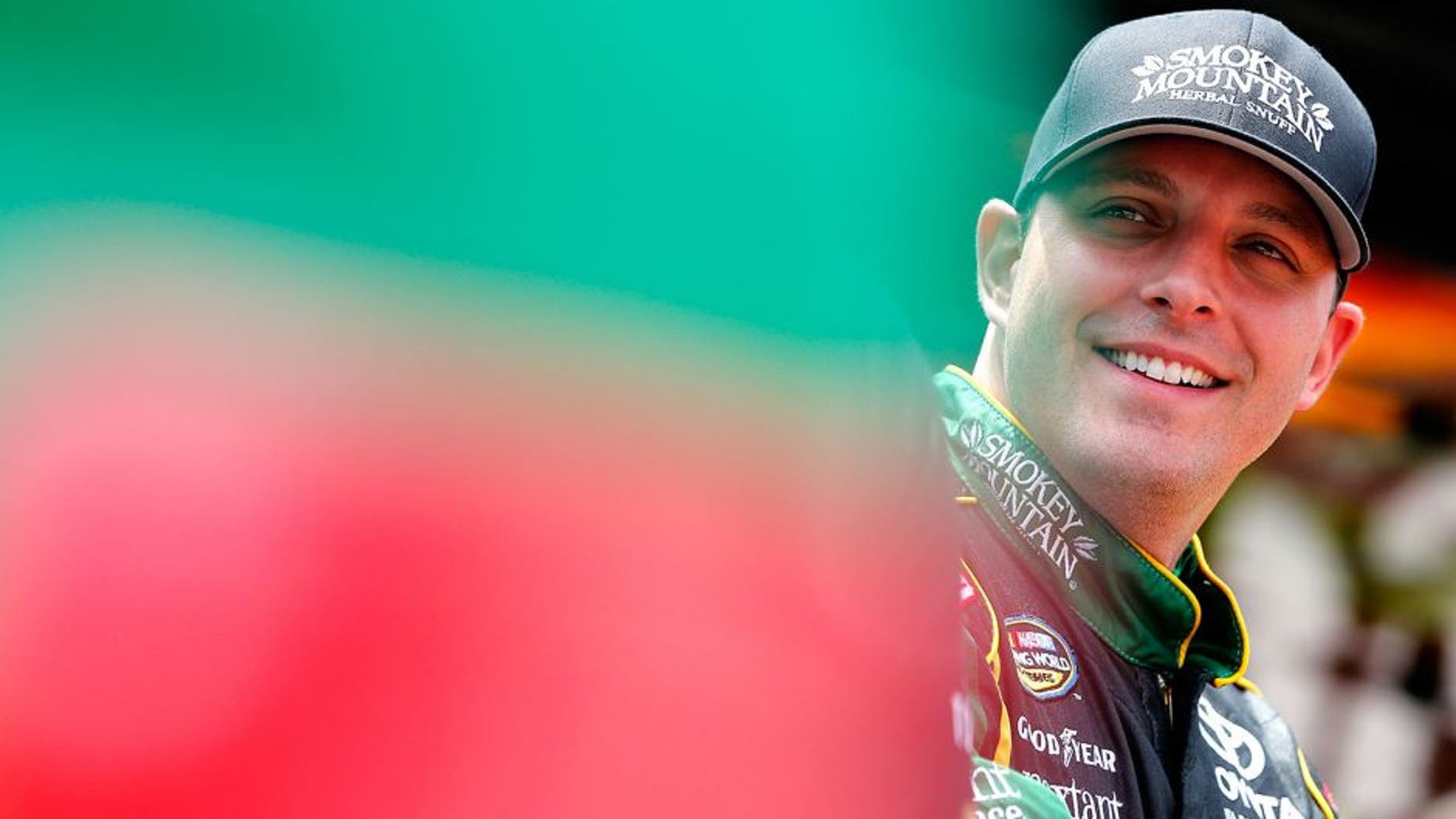 BRISTOL, TN - AUGUST 18: Johnny Sauter, driver of the #98 Smokey Mtn/Curb Records Toyota, stands in the garage during practice for the NASCAR Camping World Truck Series UNOH 200 race at Bristol Motor Speedway on August 18, 2015 in Bristol, Tennessee. (Photo by Brian Lawdermilk/NASCAR via Getty Images)