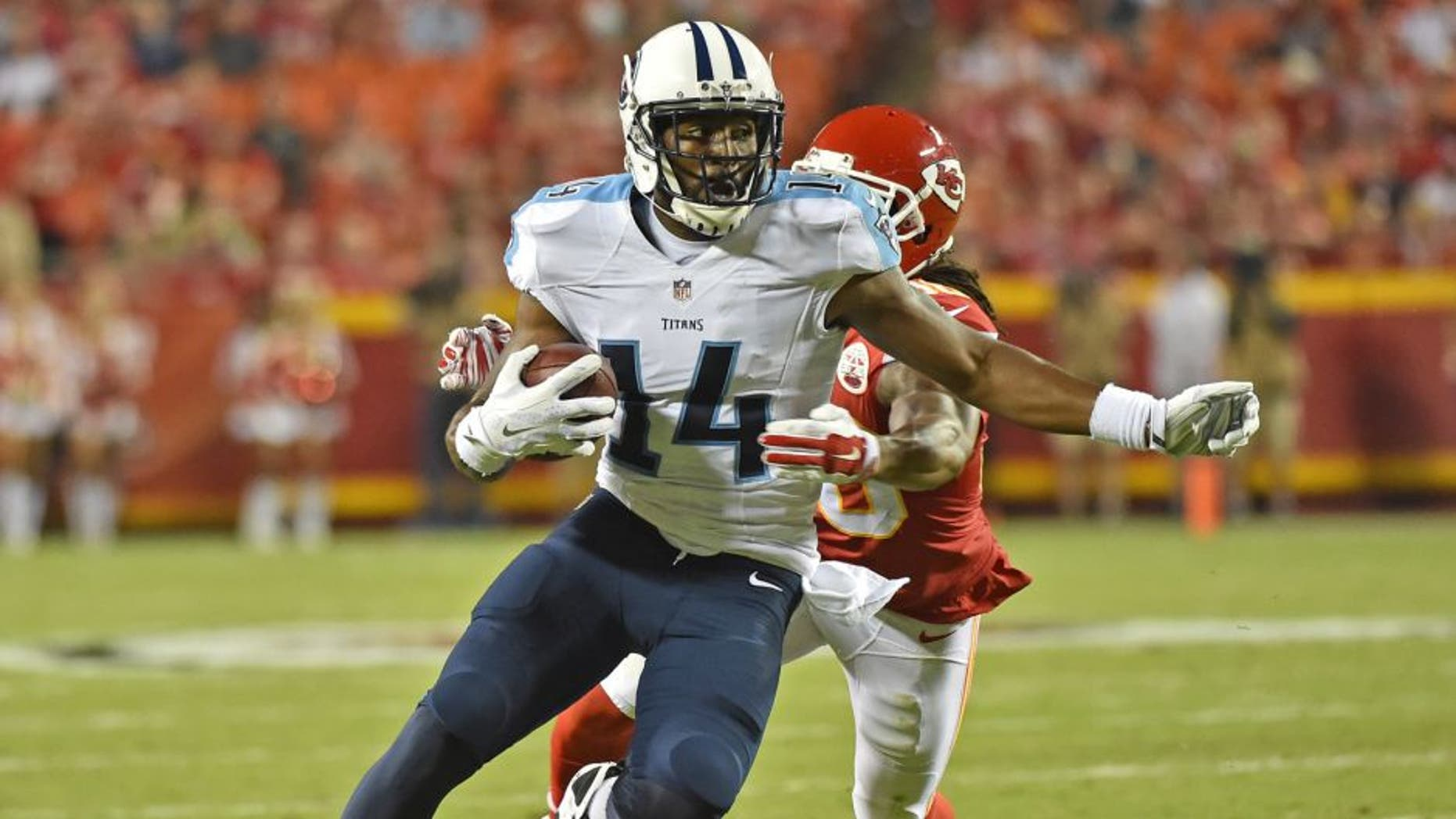 KANSAS CITY, MO - AUGUST 28: Wide receiver Hakeem Nicks #14 of the Tennessee Titans runs up field against defensive back Jamell Fleming #30 of the Kansas City Chiefs during the first half of a preseason game at Arrowhead Stadium on August 28, 2015 in Kansas City, Missouri. (Photo by Peter G. Aiken/Getty Images)