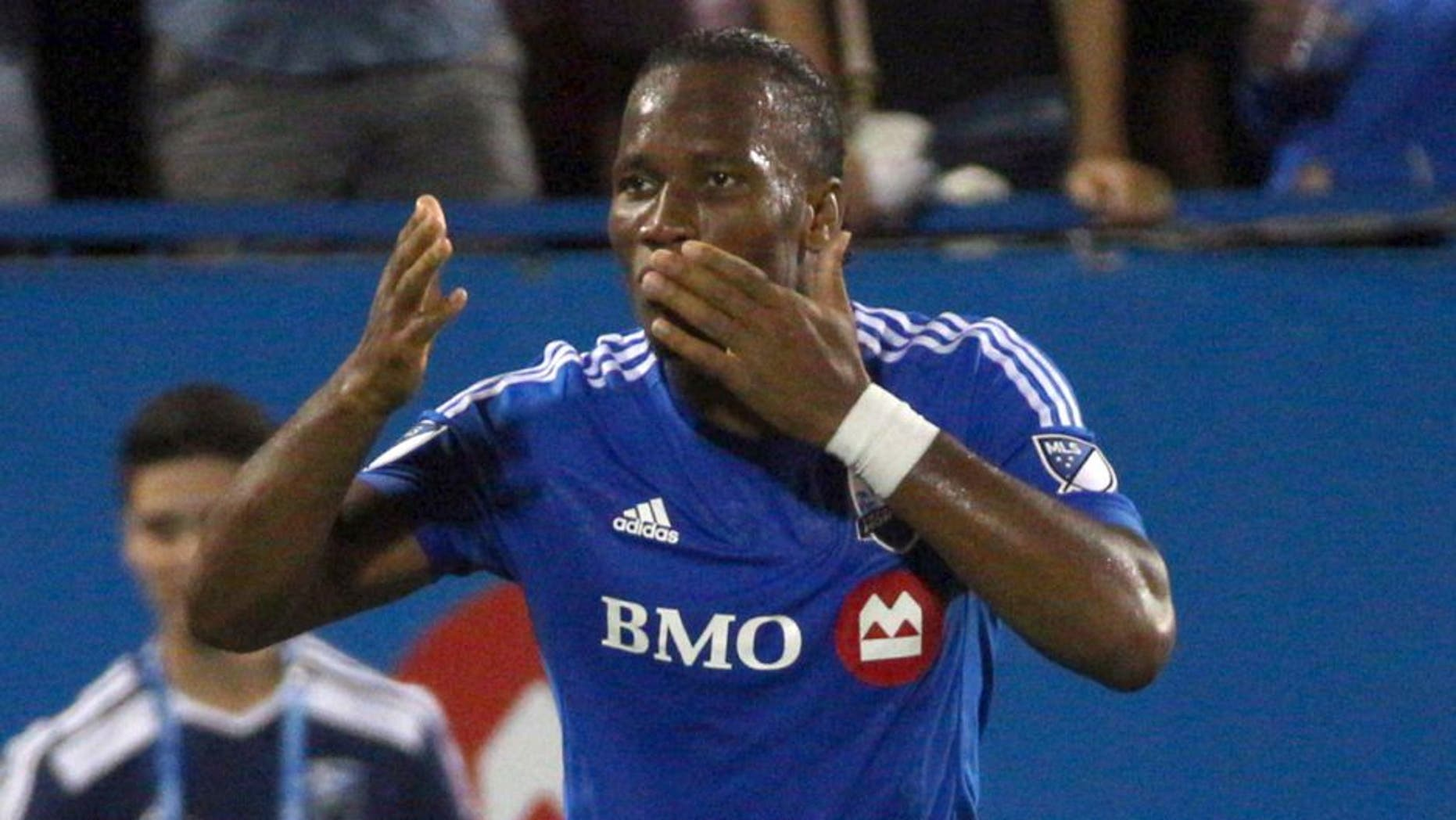 Sep 5, 2015; Montreal, Quebec, CAN; Montreal Impact forward Didier Drogba (11) celebrates his goal against Chicago Fire during the first half at the Sade Saputo. Mandatory Credit: Jean-Yves Ahern-USA TODAY Sports