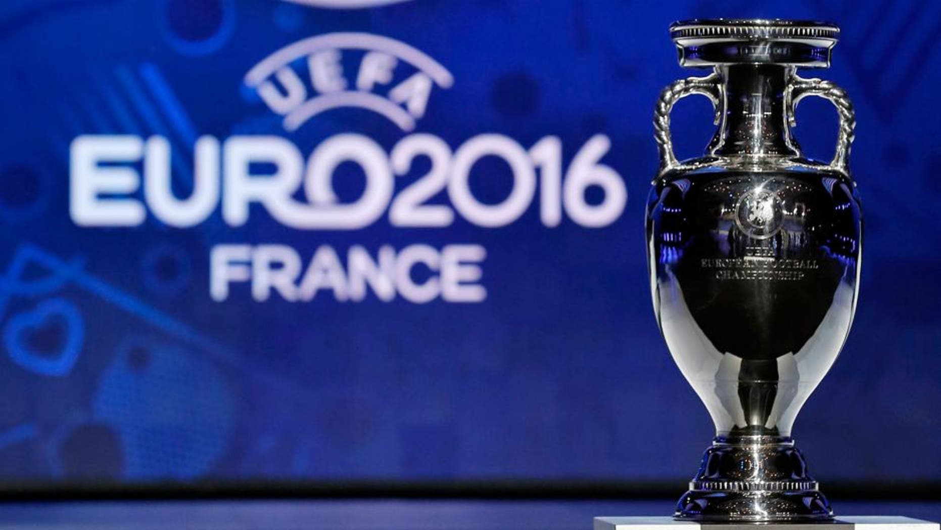 The trophy of the Euro 2016 is seen before the UEFA Euro 2016 qualifying draw in Nice, February 23, 2014. The 53 teams will be split into eight groups of six and one group of five. The top two sides in each group plus the best third-placed team will qualify directly for Euro 2016 in France. The UEFA Euro 2016 will be held in France from June 10 to July 10 2016. REUTERS/Jean-Paul Pelissier (FRANCE - Tags: SPORT SOCCER) Picture Supplied by Action Images
