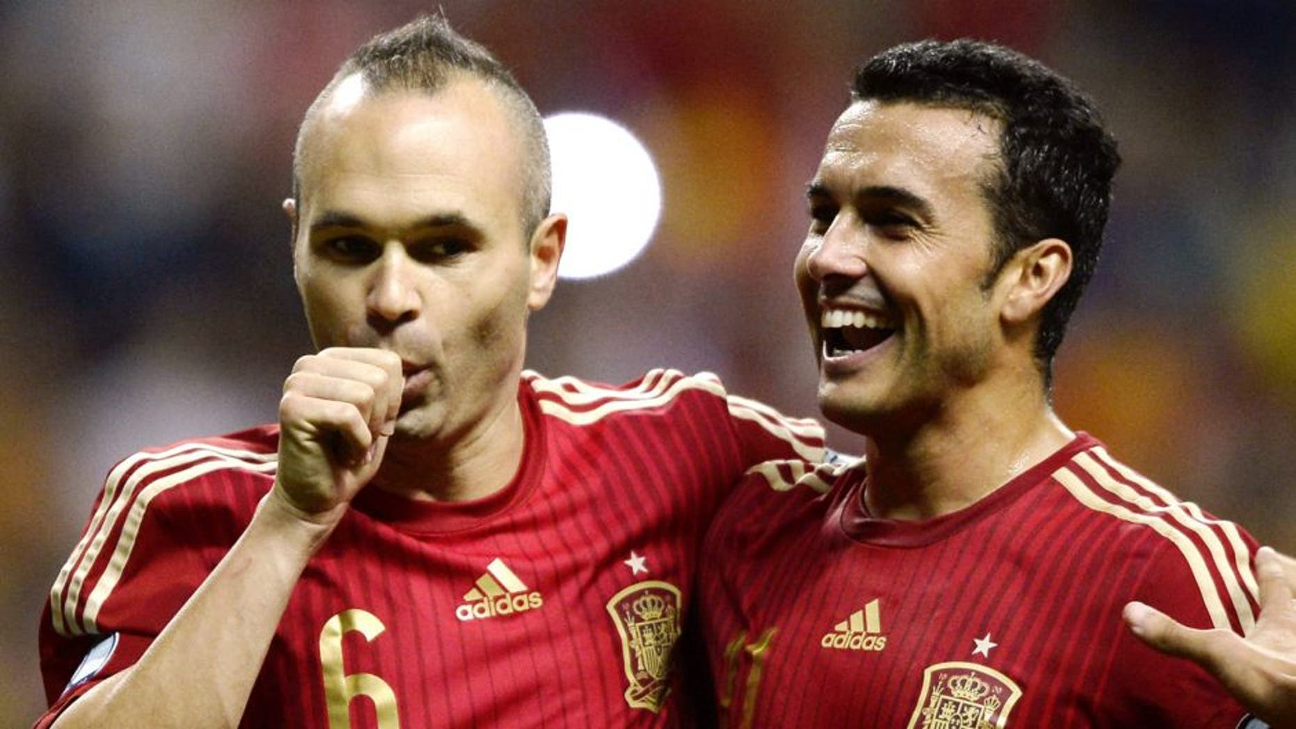 Spain's midfielder Andres Iniesta (L) celebrates with Spain's forward Pedro Rodriguez after scoring a goal during the Euro 2016 qualifying football match Spain vs Slovakia at the Carlos Tartiere stadium in Oviedo on September 5, 2015. AFP PHOTO/ MIGUEL RIOPA (Photo credit should read MIGUEL RIOPA/AFP/Getty Images)