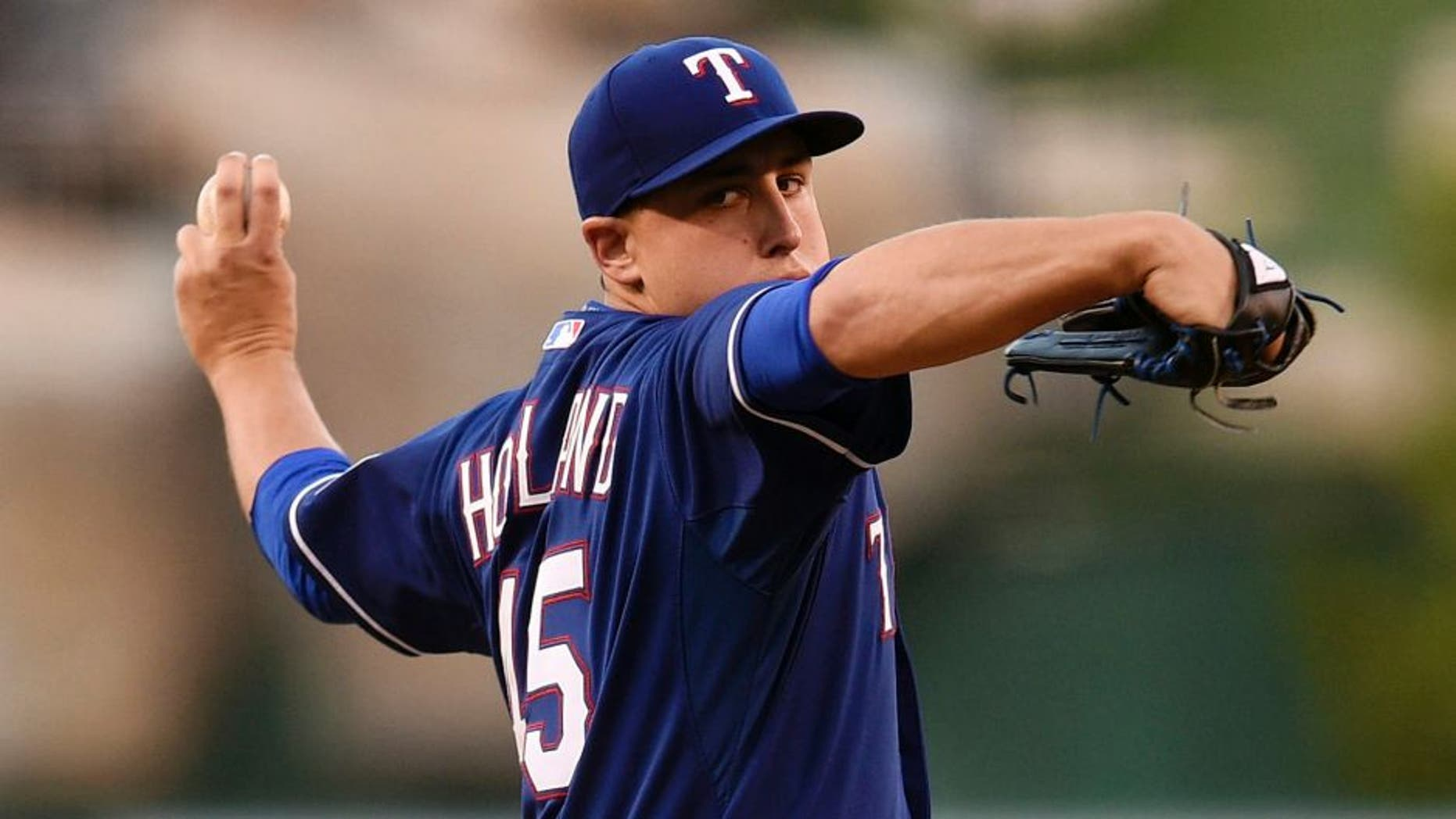 Sep 5, 2015; Anaheim, CA, USA; Texas Rangers starting pitcher Derek Holland (45) pitches against the Los Angeles Angels during the first inning at Angel Stadium of Anaheim. Mandatory Credit: Kelvin Kuo-USA TODAY Sports
