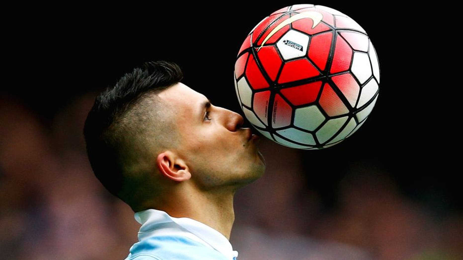 MANCHESTER, ENGLAND - OCTOBER 03: Sergio Aguero of Manchester City kisses the ball to celebrate a goal and his hat-trick during the Barclays Premier League match between Manchester City and Newcastle United at Etihad Stadium on October 3, 2015 in Manchester, United Kingdom. (Photo by Dean Mouhtaropoulos/Getty Images)