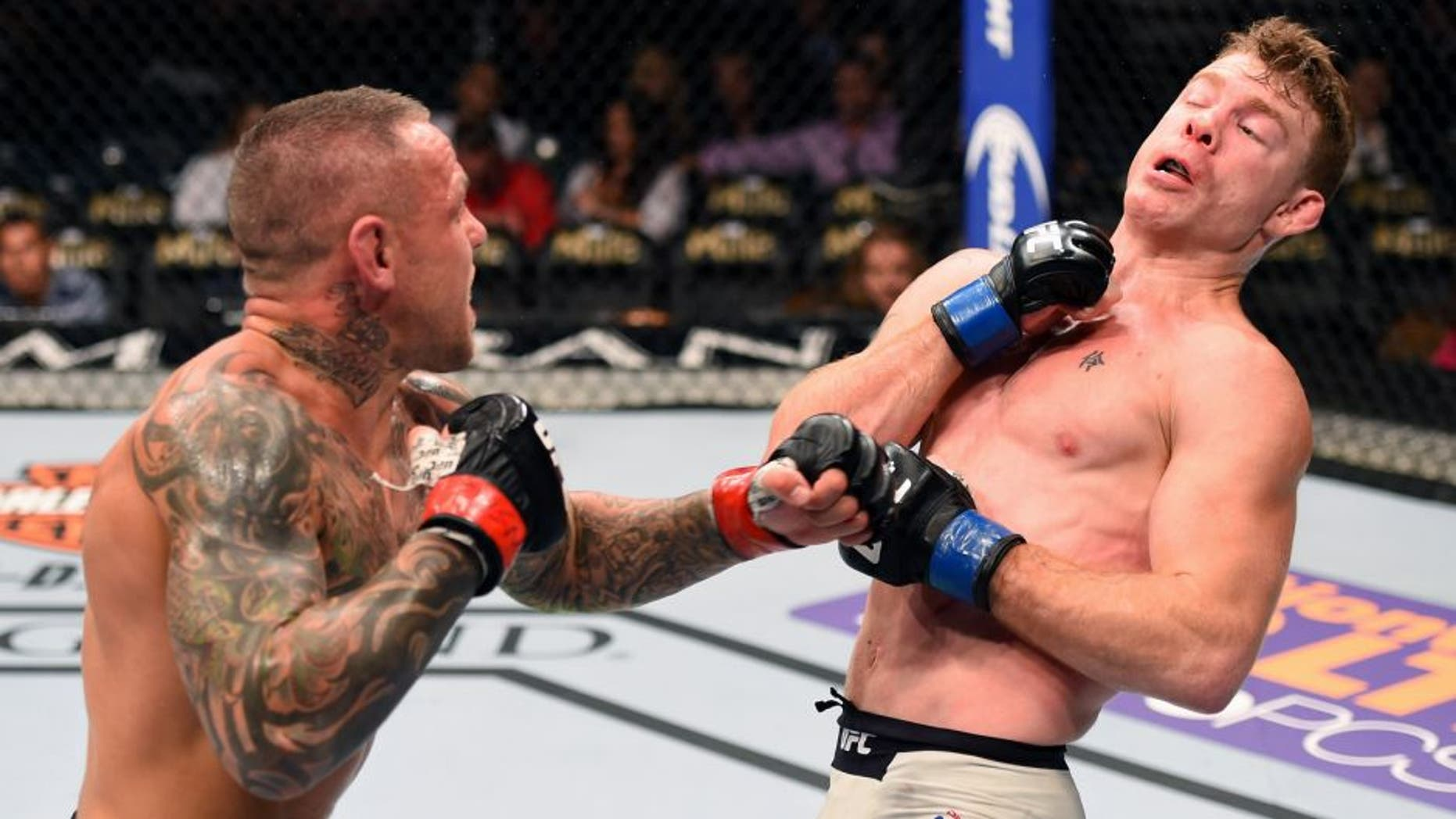 LAS VEGAS, NV - SEPTEMBER 05: (L-R) Ross Pearson punches Paul Felder in their lightweight bout during the UFC 191 event inside MGM Grand Garden Arena on September 5, 2015 in Las Vegas, Nevada. (Photo by Josh Hedges/Zuffa LLC/Zuffa LLC via Getty Images)