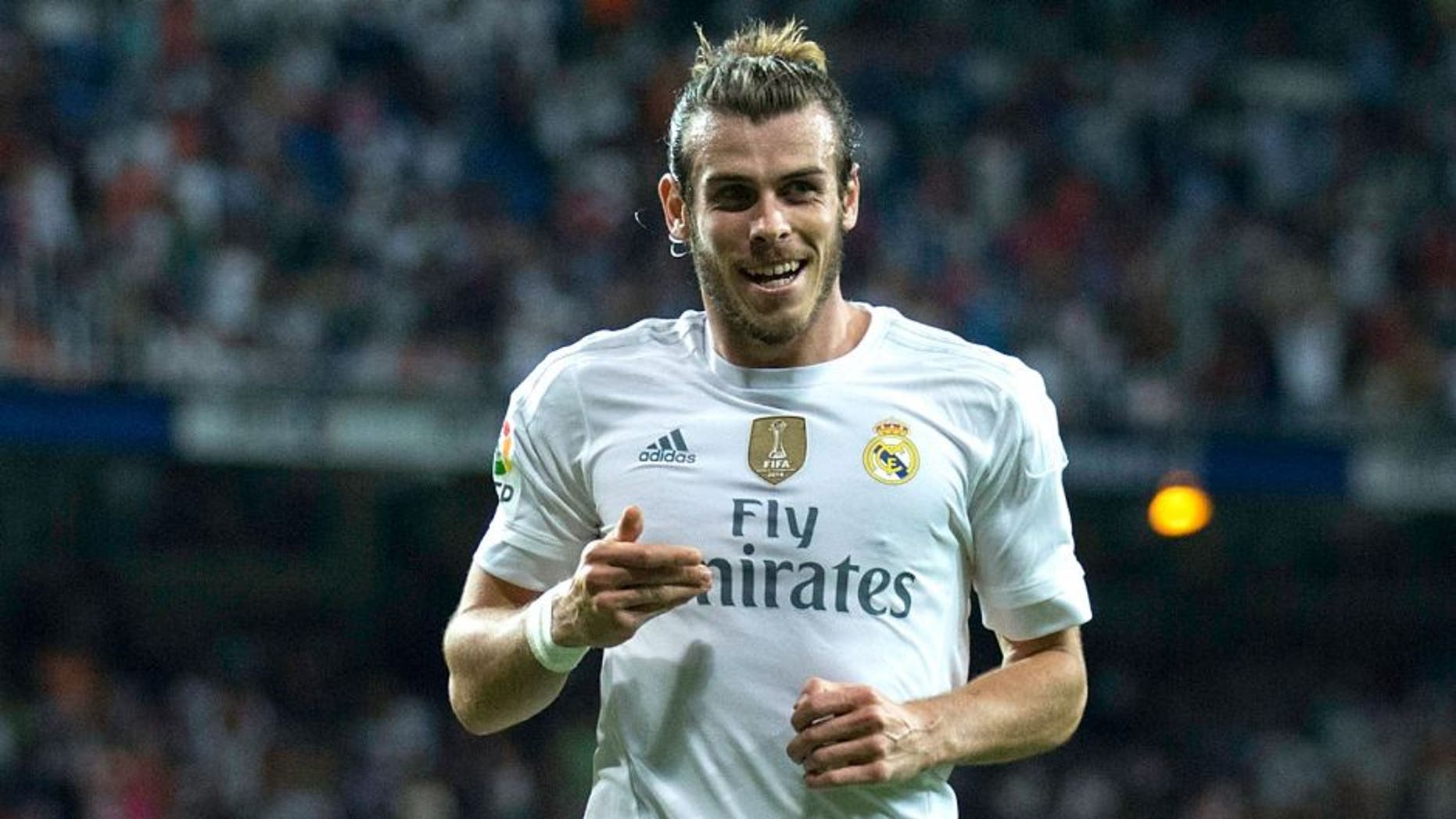 MADRID, SPAIN - AUGUST 29: Gareth Bale of Real Madrid CF celebrates scoring their fifth goal during the La Liga match between Real Madrid CF and Real Betis Balompie at Estadio Santiago Bernabeu on August 29, 2015 in Madrid, Spain. (Photo by Gonzalo Arroyo Moreno/Getty Images)