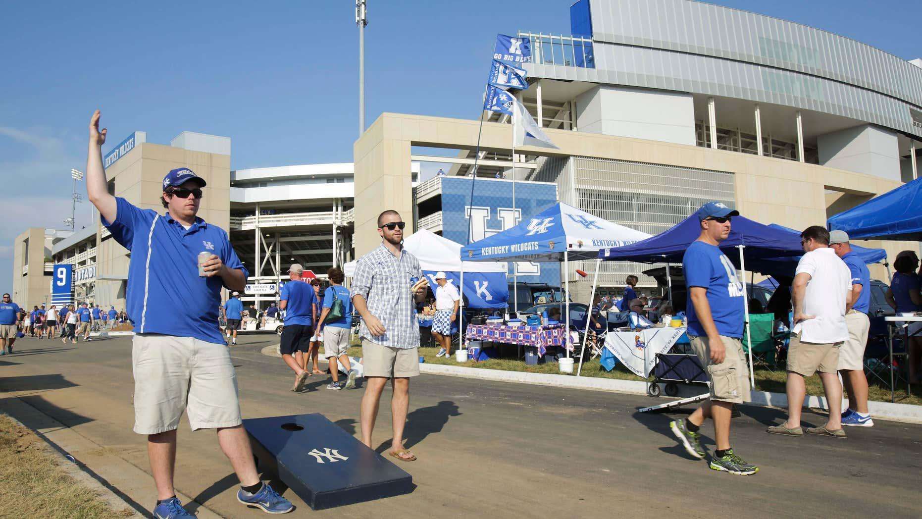 Sept. 5, 2015: Kentucky students Zac Houston, left, and Kyle Polley tailgate in the parking lot of the newly remodeled Commonwealth Stadium before Kentucky plays Louisiana-Lafayette in an NCAA college football game in Lexington, Ky.