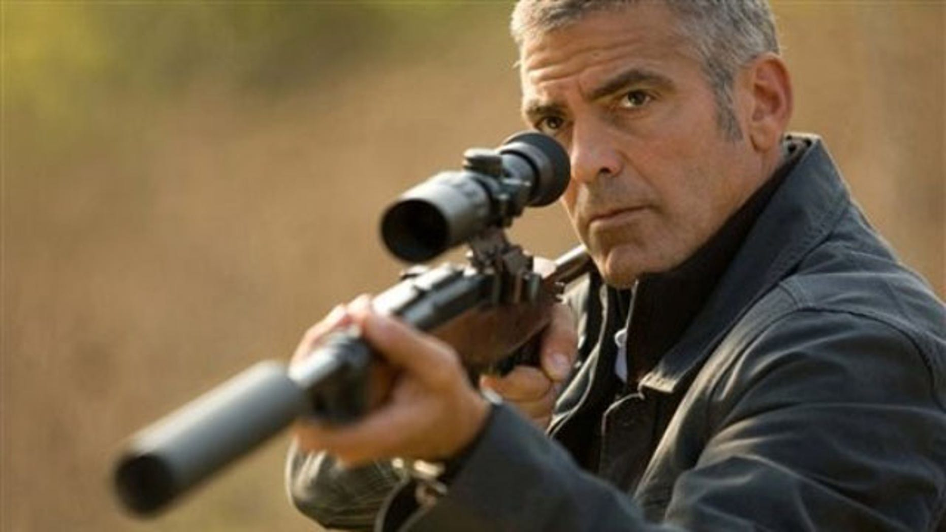 "In this film publicity image released by Focus Features, George Clooney is shown in a scene from, ""The American"" (AP)."