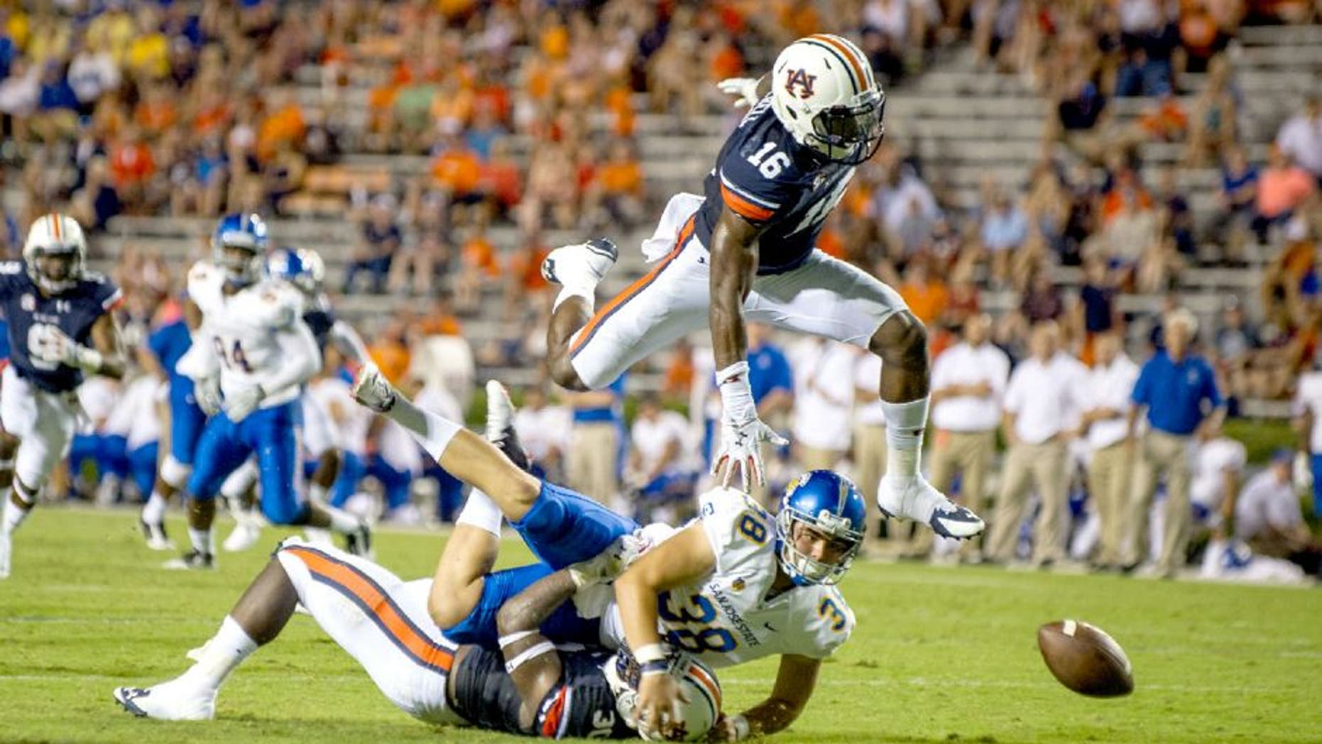 AUBURN, AL - SEPTEMBER 6: Linebacker JaViere Mitchell #16 of the Auburn Tigers leaps over linebacker Tre' Williams #30 of the Auburn Tigers and place kicker Michael Carrizosa #38 of the San Jose State Spartans to attempt to recover a fumble on September 6, 2014 at Jordan-Hare Stadium in Auburn, Alabama. Auburn defeated San Jose State 59-13. (Photo by Michael Chang/Getty Images)