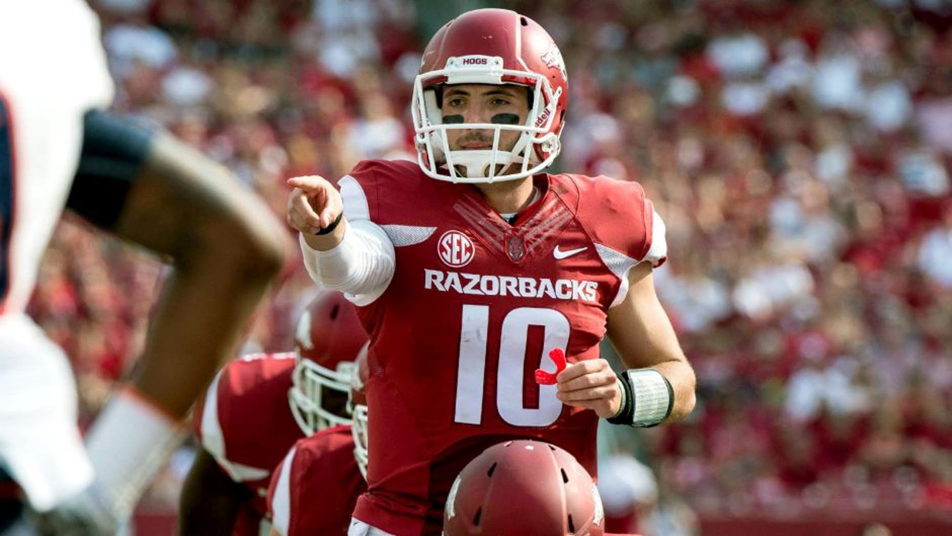 Sep 5, 2015; Fayetteville, AR, USA; Arkansas Razorbacks quarterback Brandon Allen (10) points to UTEP Miners defensive back Michael Lewis (39) during the second half at Donald W. Reynolds Razorback Stadium. The Razorbacks defeat the Miners 48-13. Mandatory Credit: Jerome Miron-USA TODAY Sports