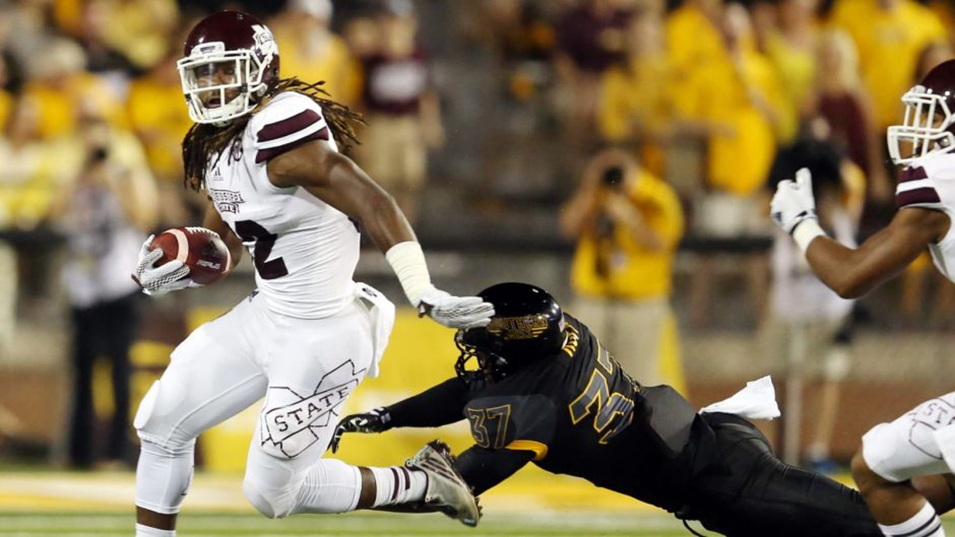Sep 5, 2015; Hattiesburg, MS, USA; Mississippi State Bulldogs running back Ashton Shumpert (32) runs away from Southern Miss Golden Eagles linebacker Sherrod Ruff (37) in the first quarter of their game at M.M. Roberts Stadium. Mandatory Credit: Chuck Cook-USA TODAY Sports