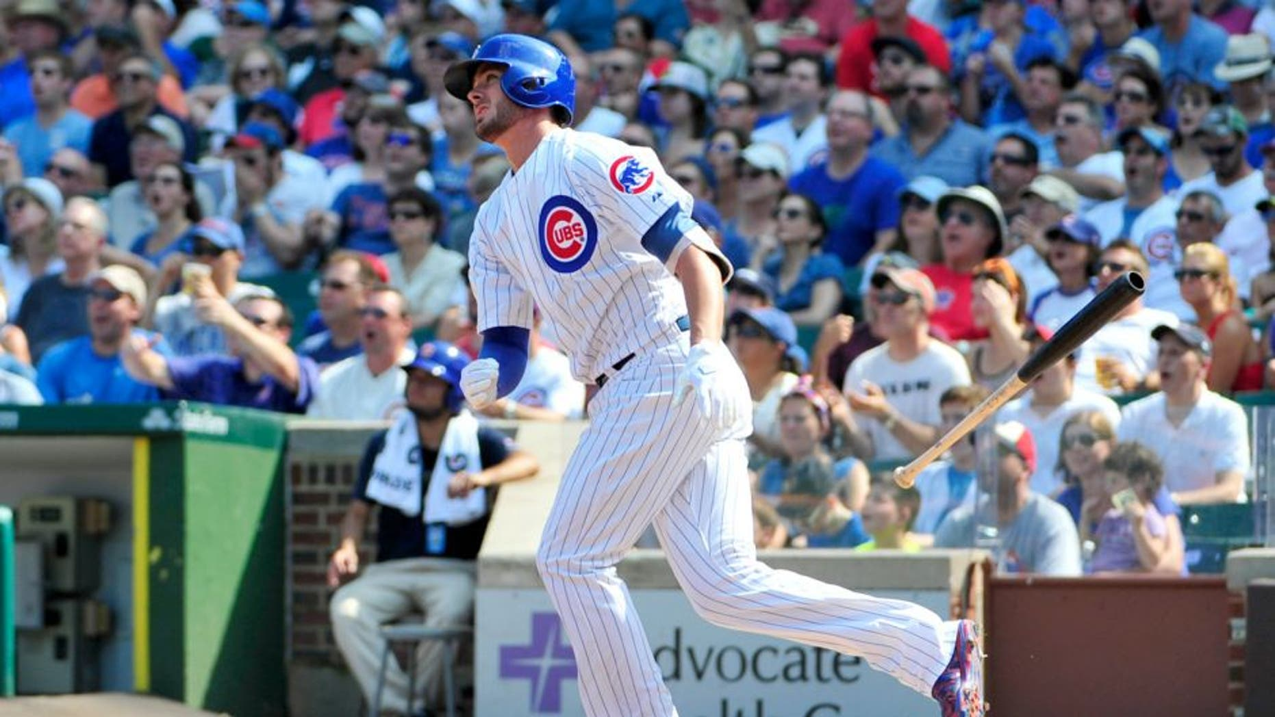CHICAGO, IL - SEPTEMBER 06: Kris Bryant #17 of the Chicago Cubs hits a home run against the Arizona Diamondbacks during the fifth inning on September 6, 2015 at Wrigley Field in Chicago, Illinois. (Photo by David Banks/Getty Images)