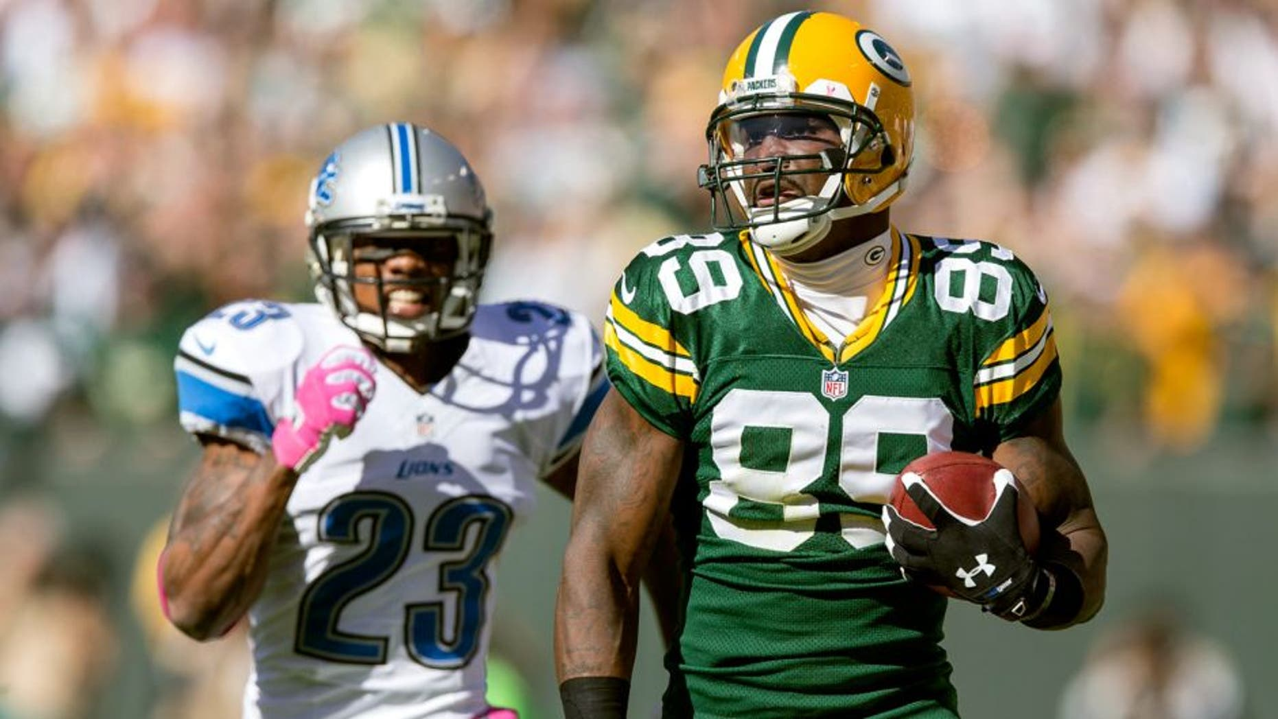 GREEN BAY, WI - OCTOBER 6: James Jones #89 of the Green Bay Packers runs during a 83 yard touchdown catch against the Chris Houston #23 of the Detroit Lions at Lambeau Field on October 6, 2013 in Green Bay, Wisconsin. The Packers defeated the Lions 22-9. (Photo Tom Lynn /Getty Images)