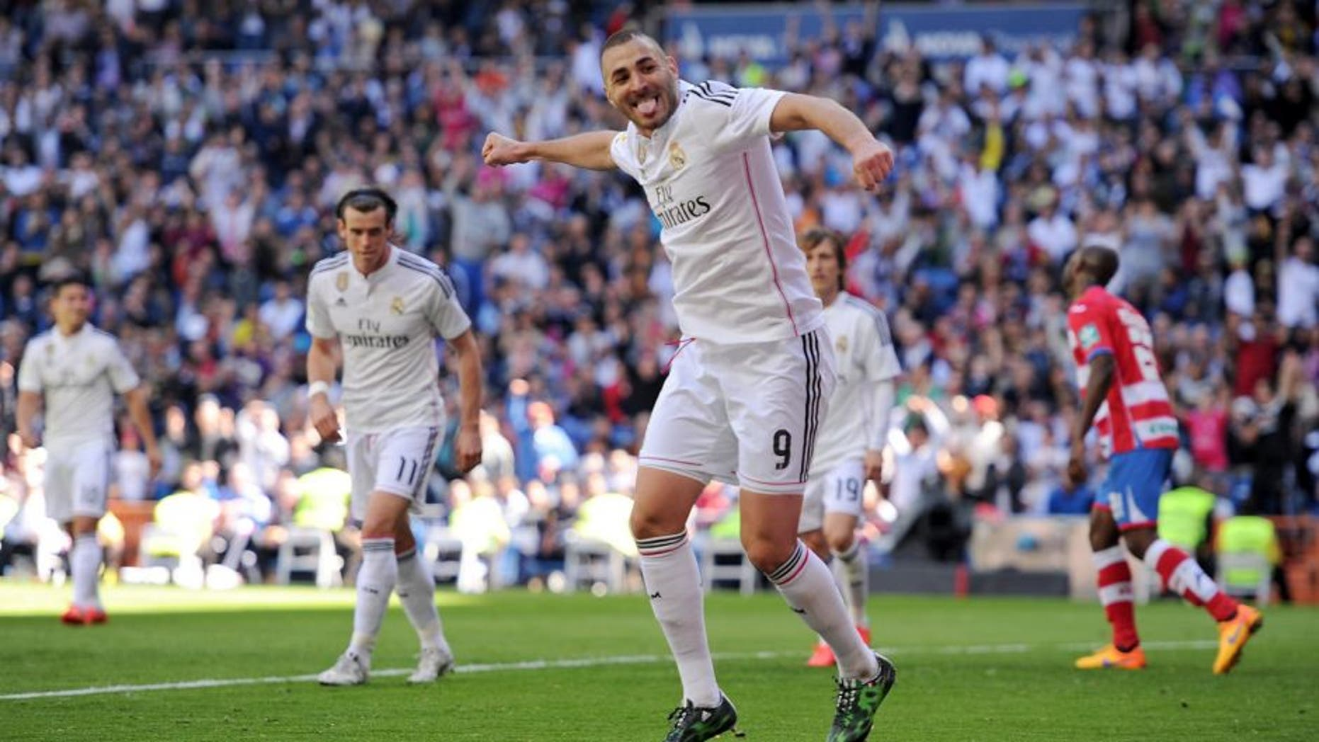 MADRID, SPAIN - APRIL 05: Karim Benzema of Real Madrid CF celebrates after scoring his team's 7th goal during the La Liga match between Real Madrid CF and Granada CF at Estadio Santiago Bernabeu on April 5, 2015 in Madrid, Spain. (Photo by Denis Doyle/Getty Images)