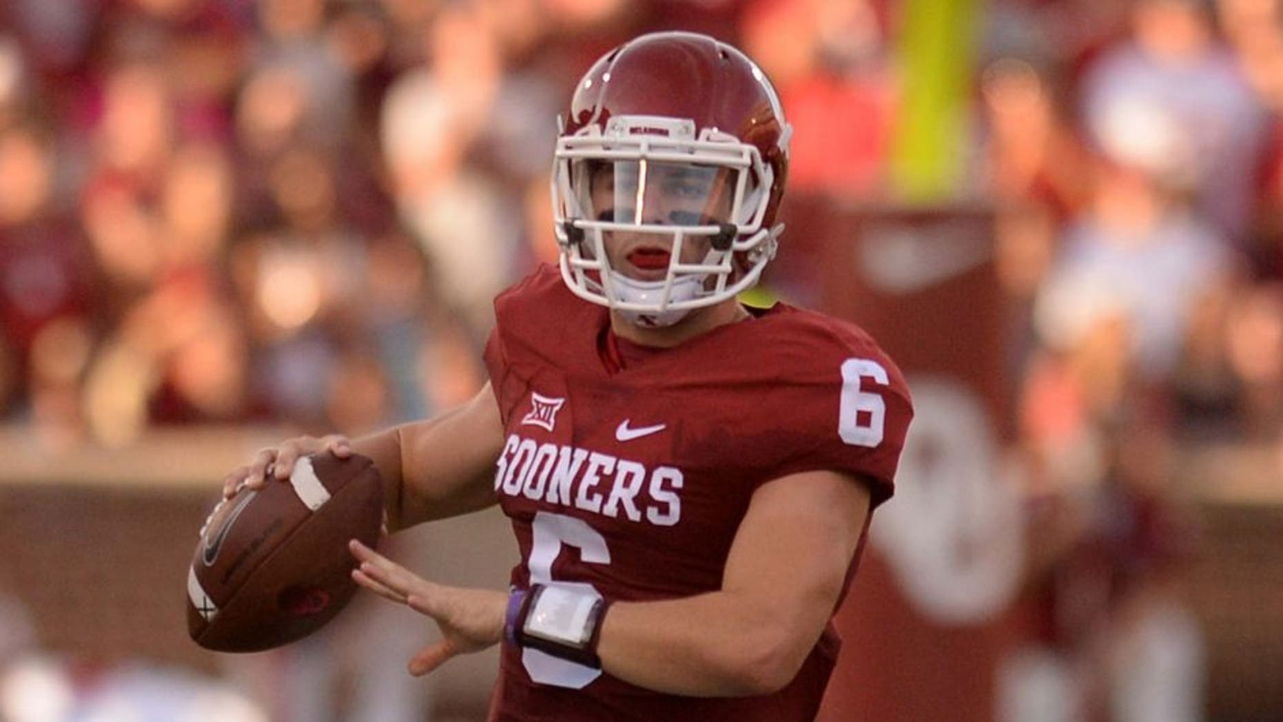Sep 5, 2015; Norman, OK, USA; Oklahoma Sooners quarterback Baker Mayfield (6) runs with the ball while being pursued by Oklahoma Sooners linebacker Tay Evans (9) during the first quarter at Gaylord Family - Oklahoma Memorial Stadium. Mandatory Credit: Mark D. Smith-USA TODAY Sports