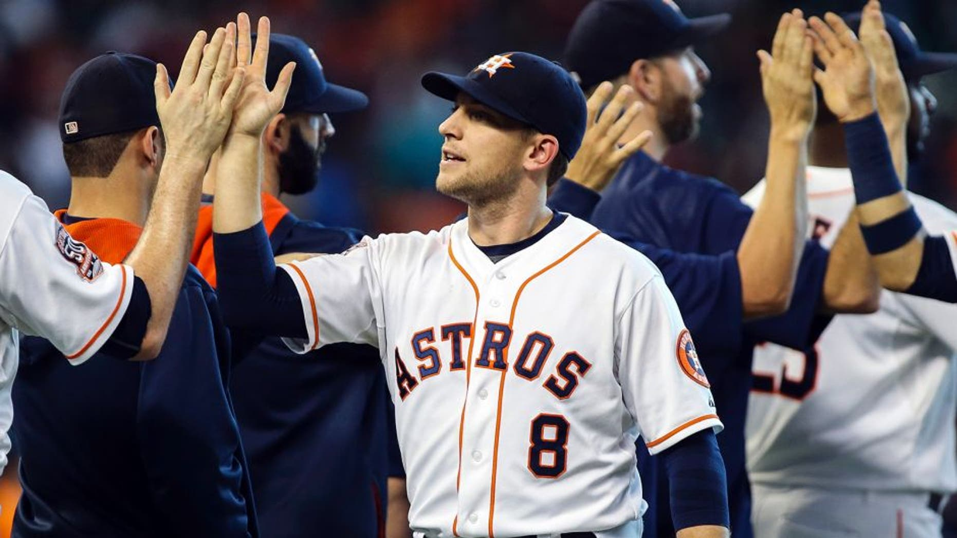 Sep 6, 2015; Houston, TX, USA; Houston Astros third baseman Jed Lowrie (8) celebrates with teammates after the Astros defeated the Minnesota Twins 8-5 at Minute Maid Park. Mandatory Credit: Troy Taormina-USA TODAY Sports
