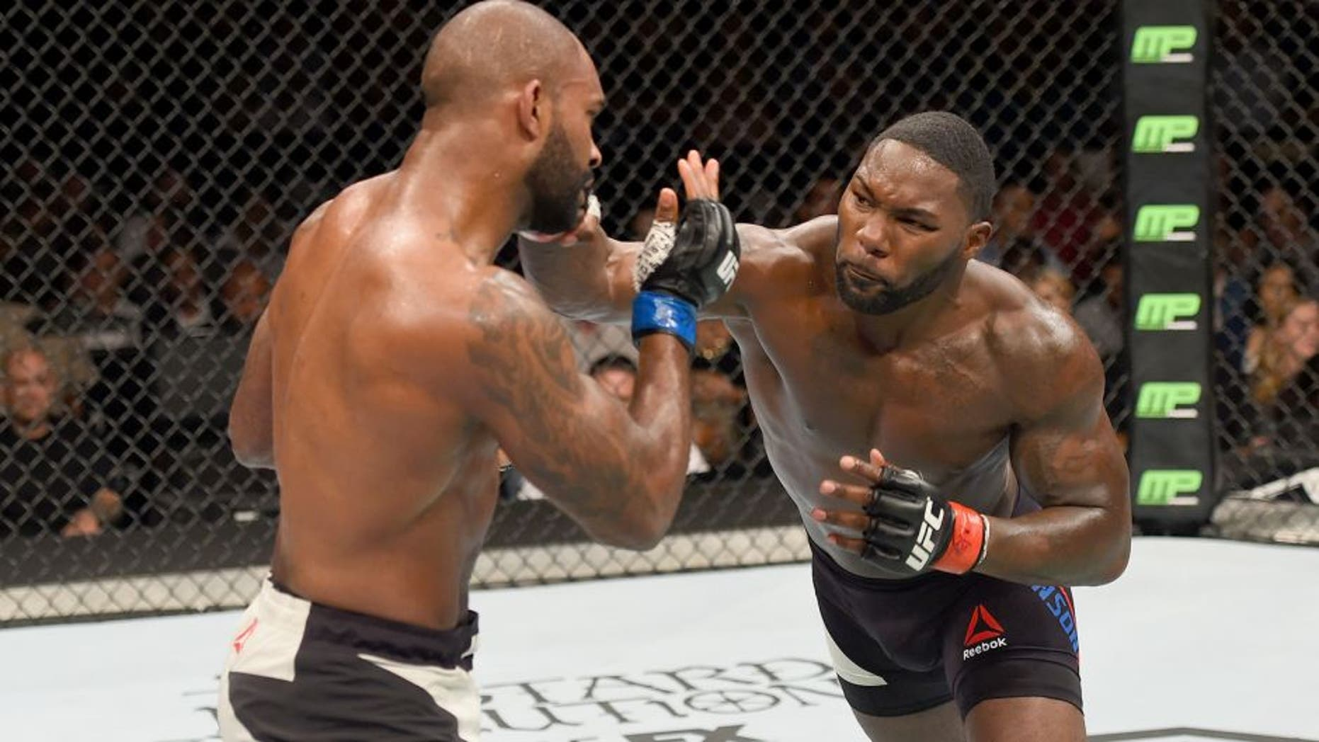 LAS VEGAS, NV - SEPTEMBER 05: (R-L) Anthony Johnson punches Jimi Manuwa in their light heavyweight bout during the UFC 191 event inside MGM Grand Garden Arena on September 5, 2015 in Las Vegas, Nevada. (Photo by Josh Hedges/Zuffa LLC/Zuffa LLC via Getty Images)