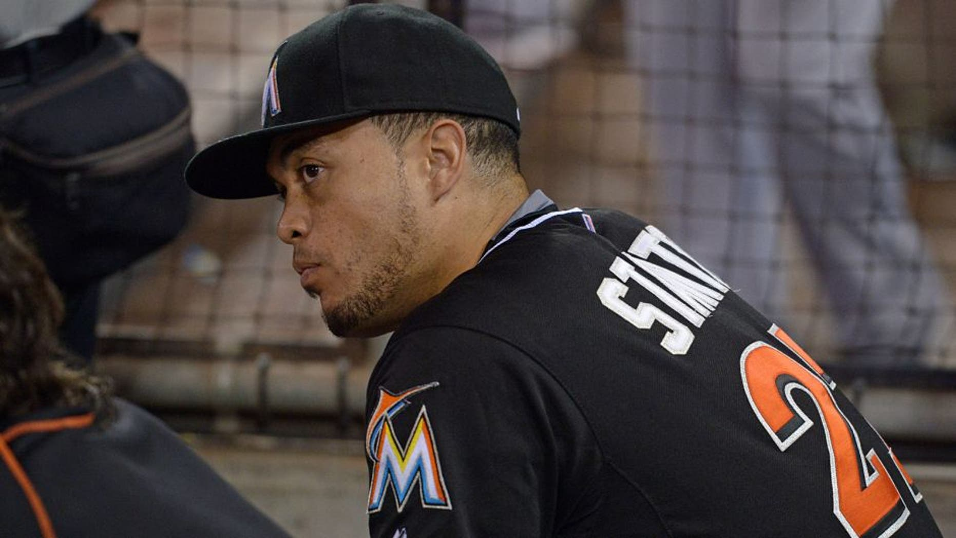 Jul 25, 2015; San Diego, CA, USA; Miami Marlins right fielder Giancarlo Stanton (27) watches game action during the ninth inning against the San Diego Padres at Petco Park. Mandatory Credit: Jake Roth-USA TODAY Sports