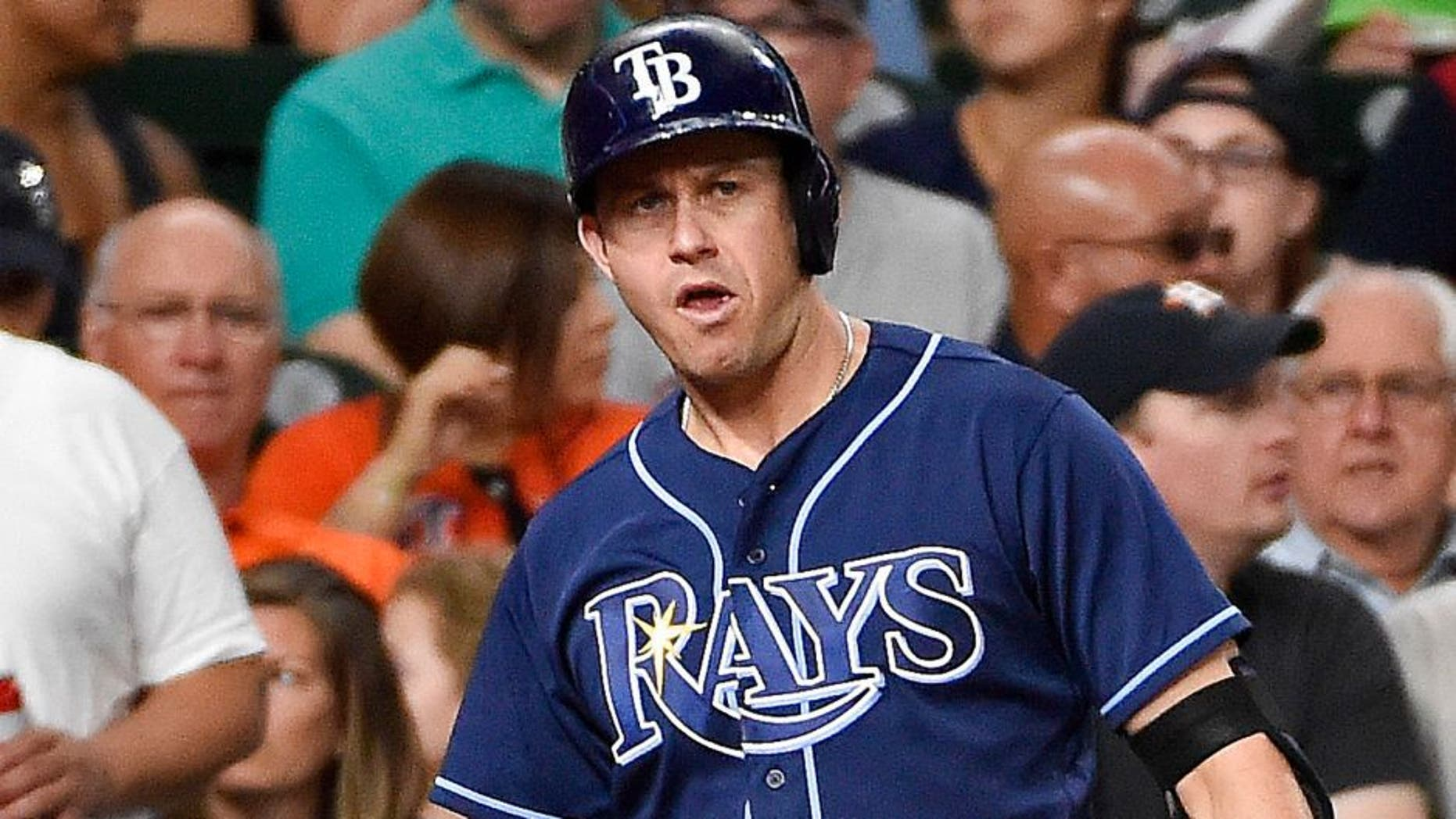 Tampa Bay Rays designated hitter Corey Dickerson (10) shakes hands with Evan Longoria after scoring a run on a wild pitch by Houston Astros' Mike Fiers during the third inning of a baseball game, Friday, Aug. 26, 2016, in Houston. (AP Photo/Eric Christian Smith)