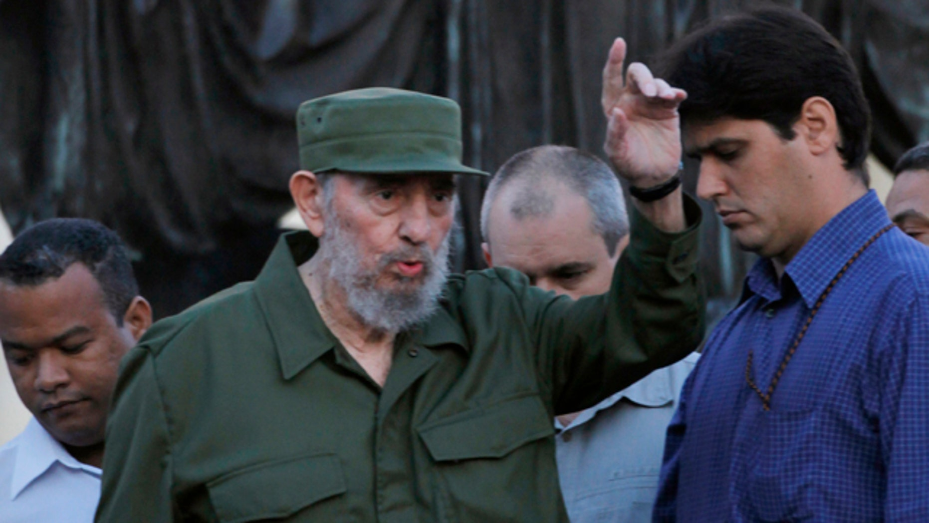 Sept. 3: Cuba's leader Fidel Castro greets students before delivering a speech outside Havana's University in Havana, Cuba.