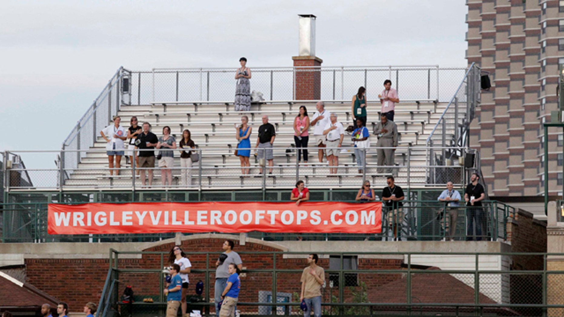 Aug. 30: Baseball fans are seen in one of the many rooftop venues outside Wrigley Field in Chicago and in the bleacher seats, foreground, to watch a baseball game between the Chicago Cubs and Pittsburgh Pirates.