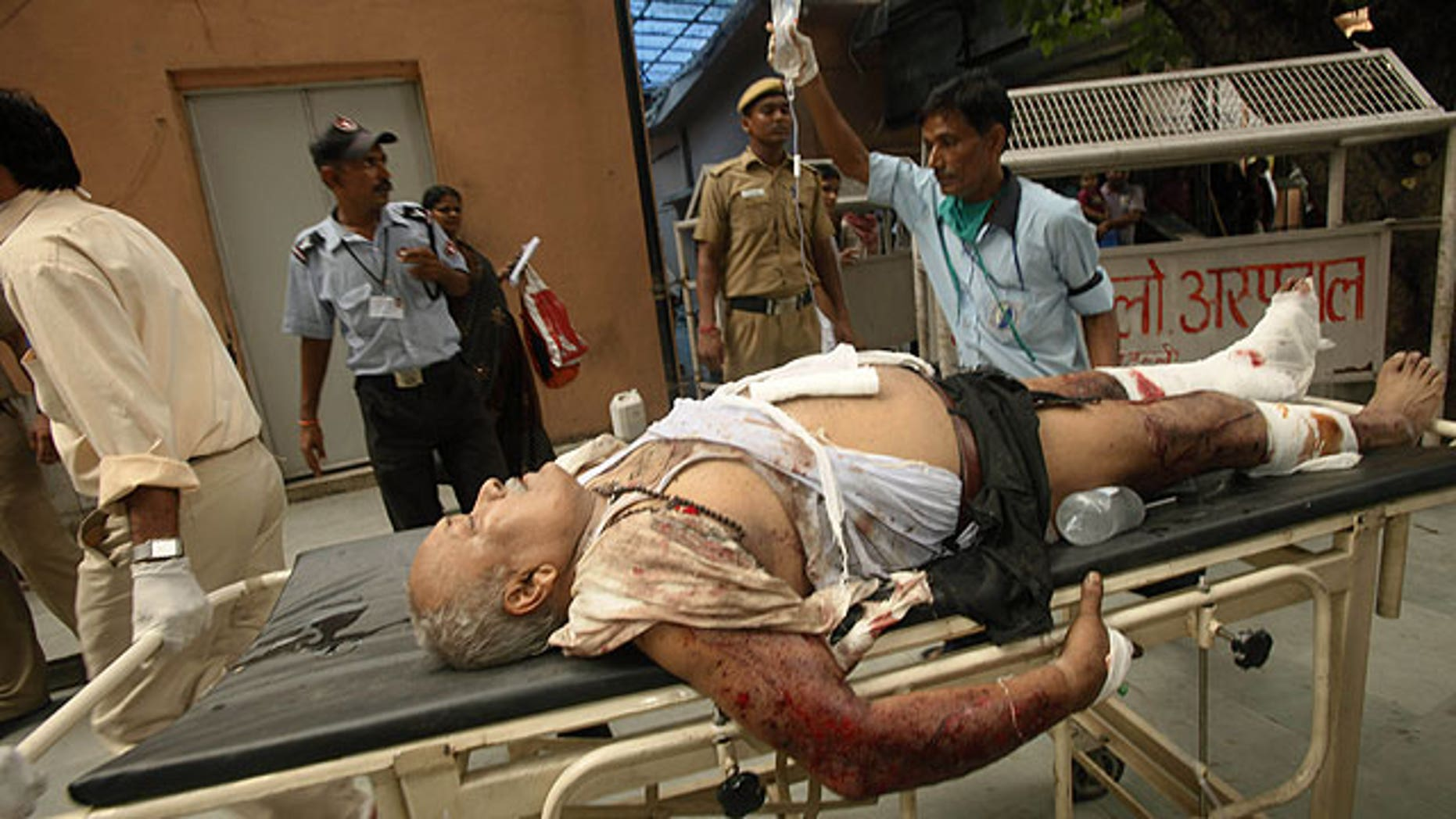 September 7: A man injured in bomb blast is brought to the RML hospital in New Delhi, India.