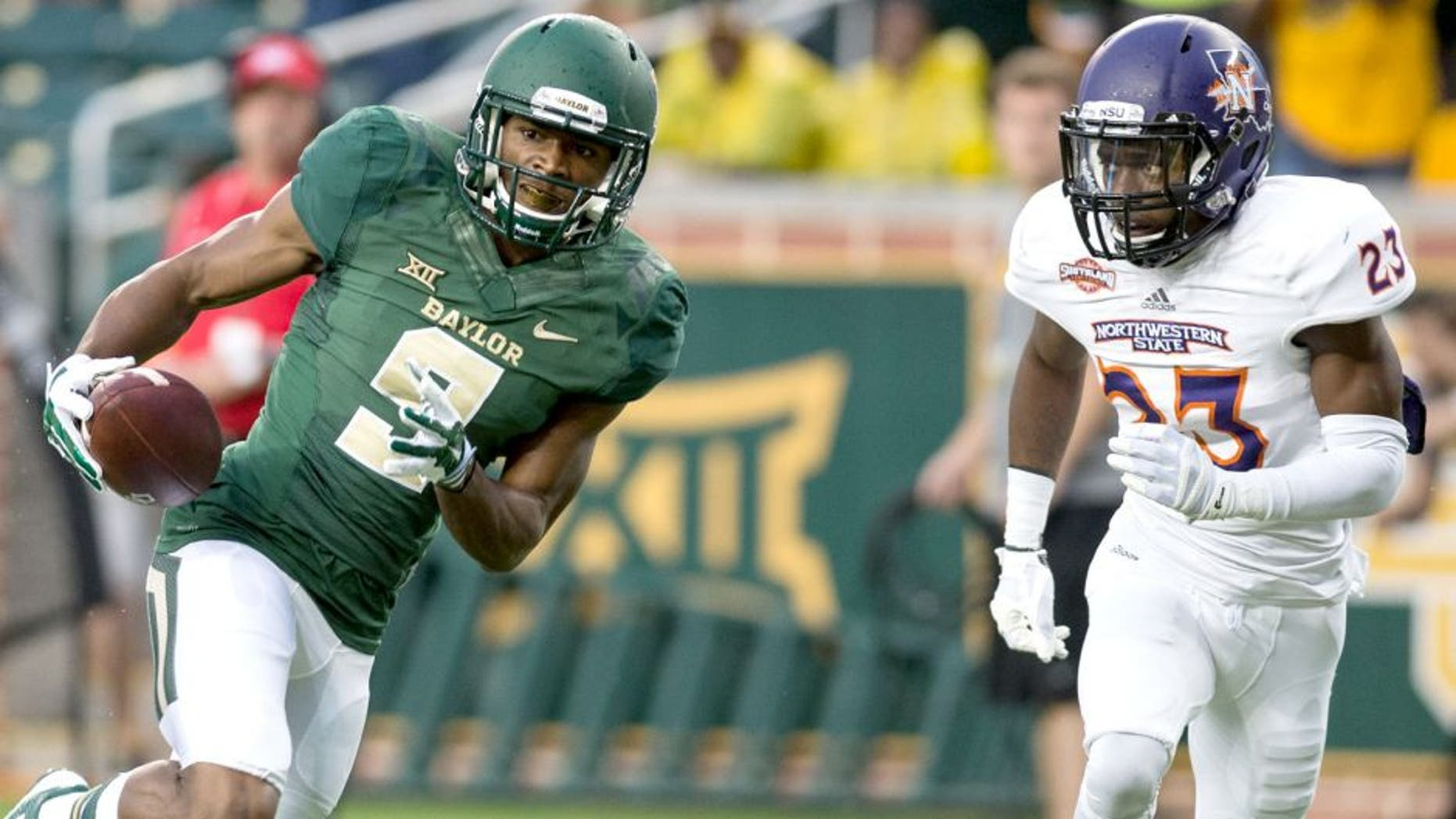 Sep 6, 2014; Waco, TX, USA; Baylor Bears wide receiver KD Cannon (9) catches a pass for a touchdown as Northwestern State Demons cornerback Fred Thomas (23) defends during the first quarter at McLane Stadium. Mandatory Credit: Jerome Miron-USA TODAY Sports