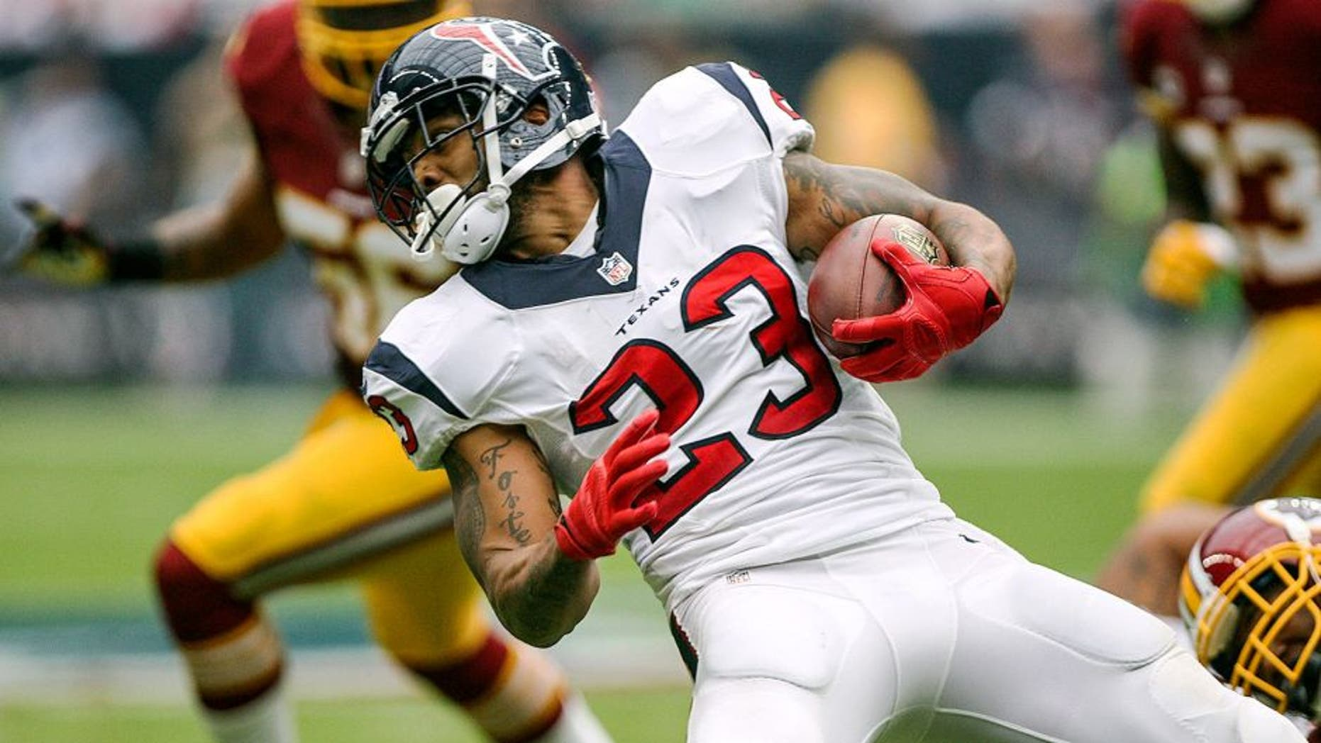 Sep 7, 2014; Houston, TX, USA; Houston Texans running back Arian Foster (23) runs with the ball during the first quarter against the Washington Redskins at NRG Stadium. Mandatory Credit: Troy Taormina-USA TODAY Sports