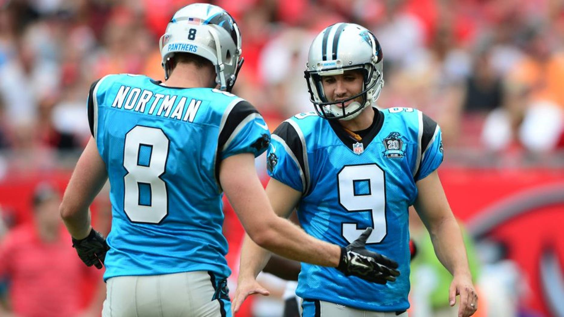 Sep 7, 2014; Tampa, FL, USA; Carolina Panthers punter Brad Nortman (8) congratulates kicker Graham Gano (9) after a field goal during the second quarter against the Tampa Bay Buccaneers at Raymond James Stadium. Mandatory Credit: Andrew Weber-USA TODAY Sports