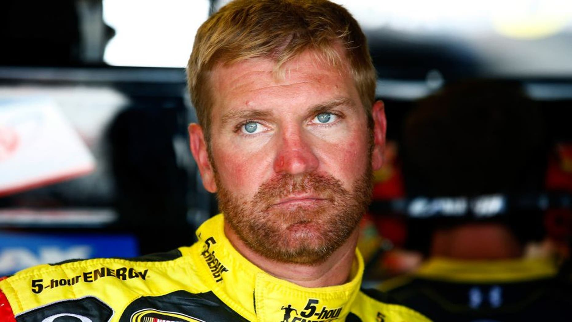 RICHMOND, VA - SEPTEMBER 05: Clint Bowyer, driver of the #15 5-hour ENERGY Toyota, stands in the garage area during practice for the NASCAR Sprint Cup Series Federated Auto Parts 400 at Richmond International Raceway on September 5, 2014 in Richmond, Virginia. (Photo by Jared Wickerham/Getty Images)