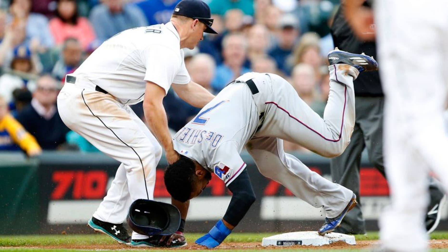 Sep 7, 2015; Seattle, WA, USA; Texas Rangers center fielder Delino DeShields (7) is out at third base after getting tagged by Seattle Mariners third baseman Kyle Seager (15) during the seventh inning at Safeco Field. Mandatory Credit: Jennifer Buchanan-USA TODAY Sports