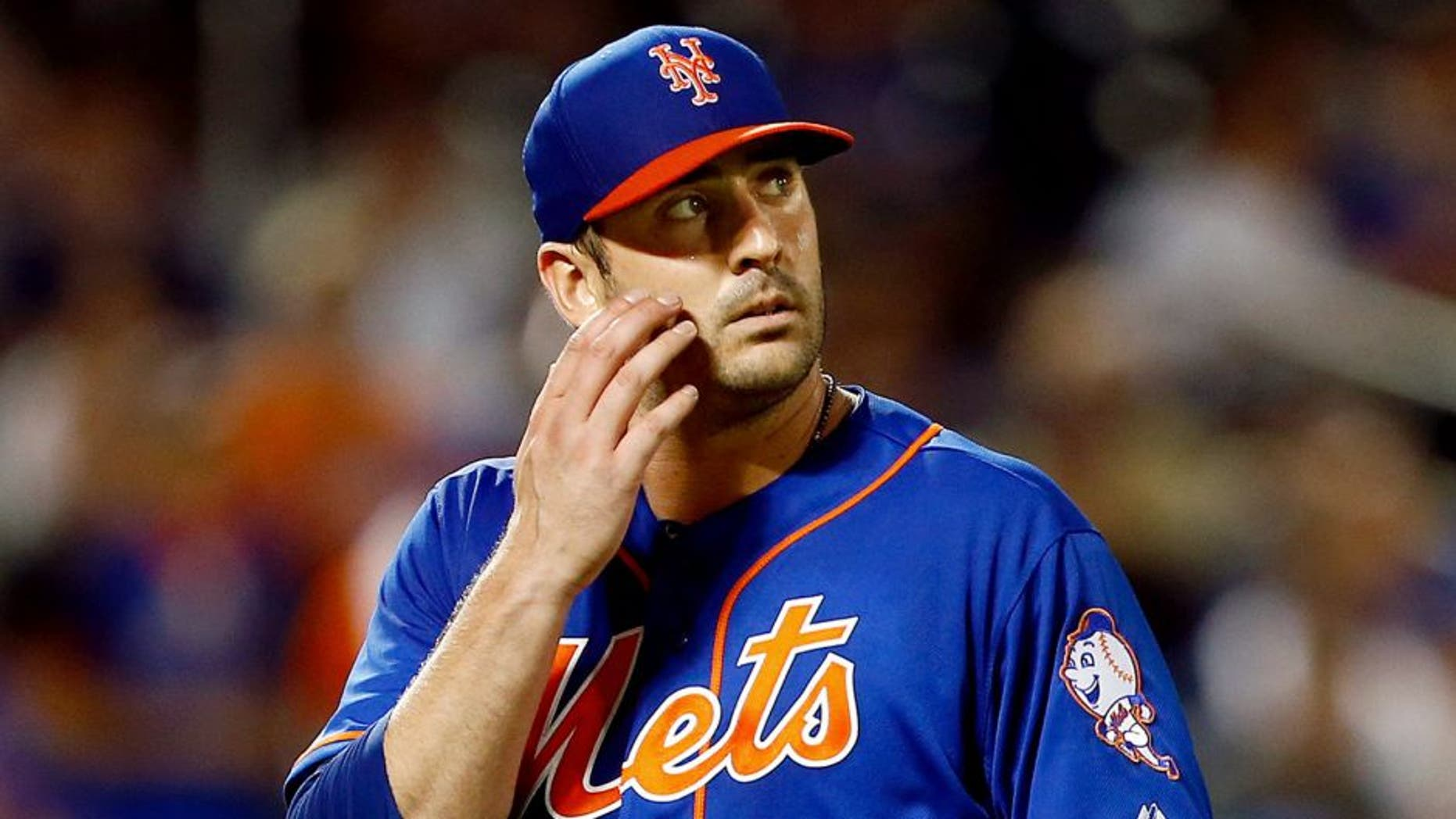 NEW YORK, NY - MAY 29: Matt Harvey #33 of the New York Mets walks off the mound against the Miami Marlins during a game on May 29, 2015 at Citi Field in the Flushing neighborhood of the Queens borough of New York City. (Photo by Rich Schultz/Getty Images)