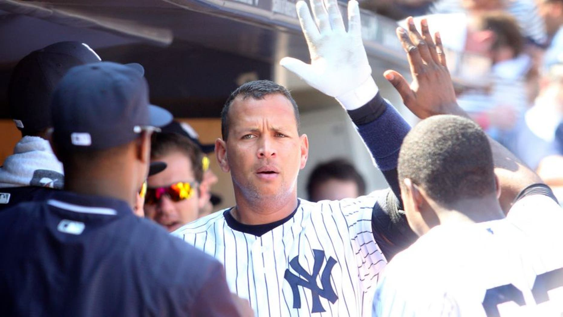 Sep 7, 2015; Bronx, NY, USA; New York Yankees designated hitter Alex Rodriguez (13) is congratulated in the dugout after hitting a solo home run against the Baltimore Orioles during the fifth inning at Yankee Stadium. Mandatory Credit: Brad Penner-USA TODAY Sports