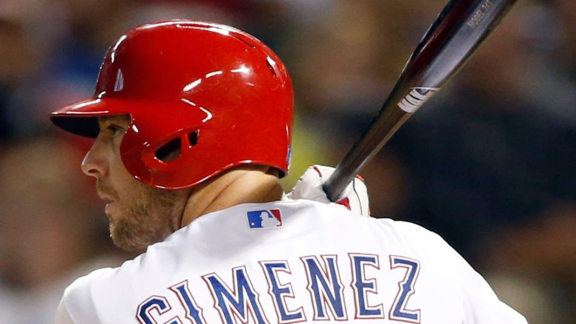 Aug 28, 2015; Arlington, TX, USA; Texas Rangers catcher Chris Gimenez (38) bats in the seventh inning against the Baltimore Orioles at Globe Life Park in Arlington. Texas won 4-1. Mandatory Credit: Tim Heitman-USA TODAY Sports